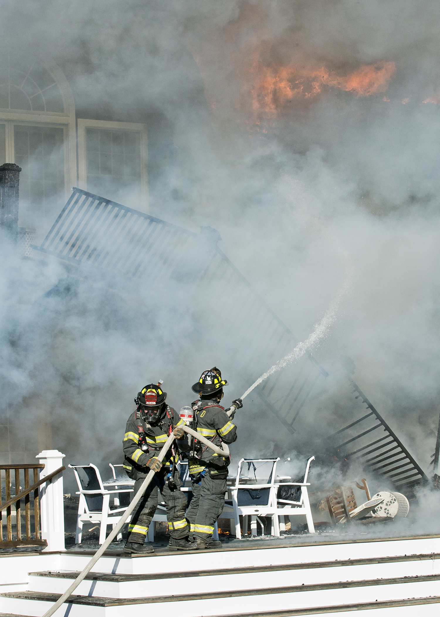 Firefighters atttacking the flames at a home on Michaels Way in Westhampton Beach yesterday afternoon.