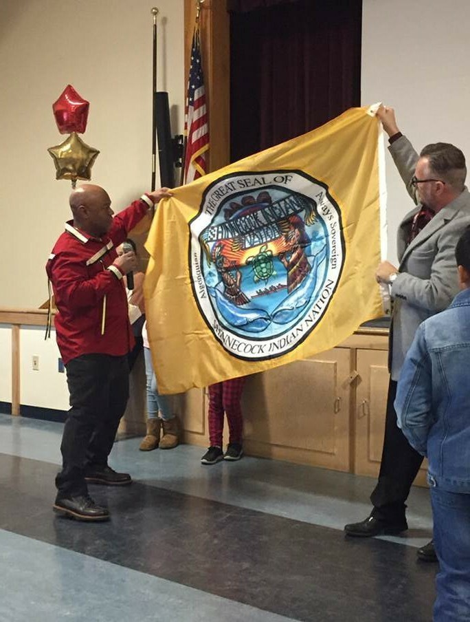 Shinnecock Nation Tribal Trustee Germain Smith  presented the Tuckahoe Common School District with the Shinnecock Nation flag, accepted by Superintendent  Len Skuggevik. The gift was in recognition of the district's