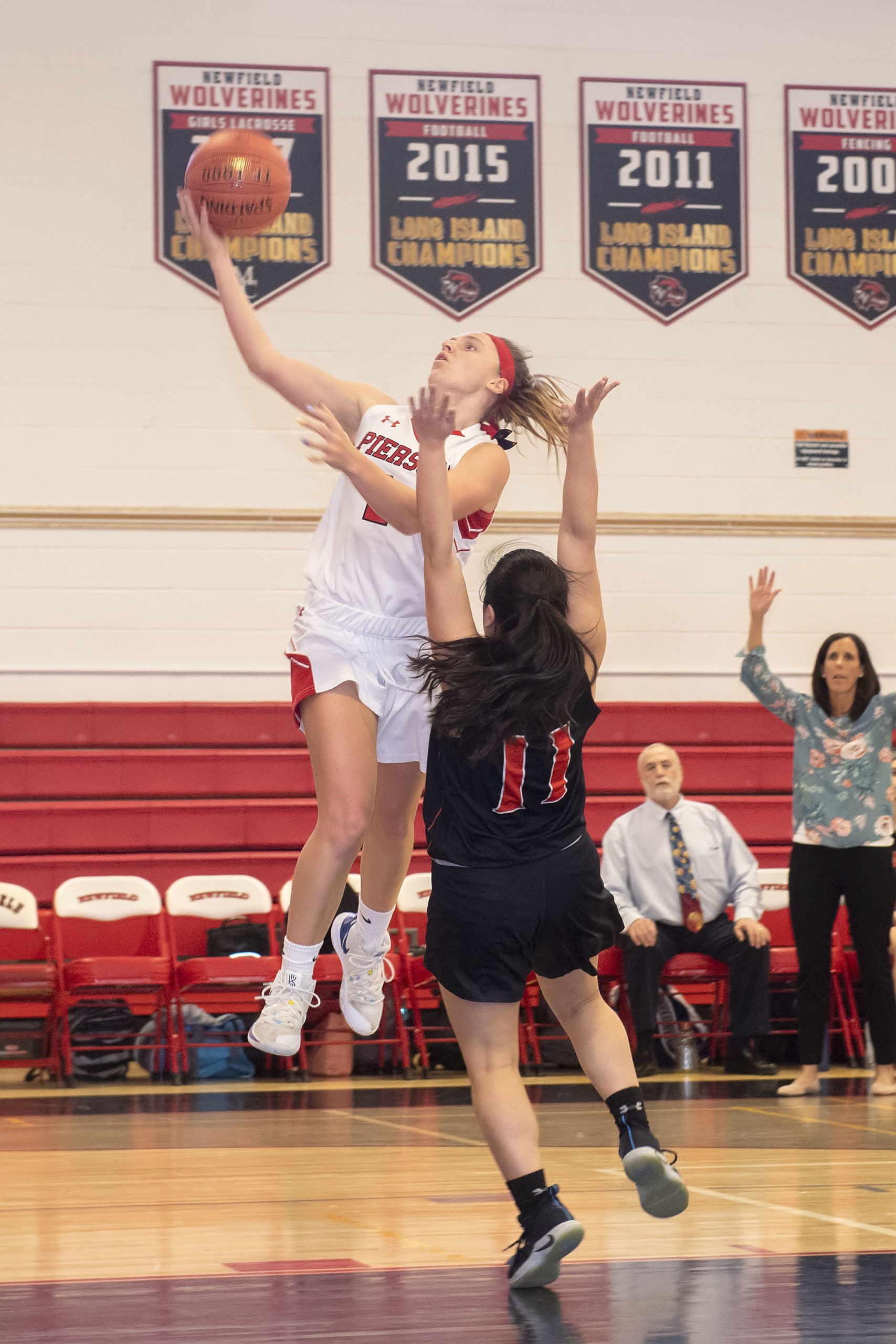 Pierson junior Grace Perello takes on an East Rockaway player as she heads toward the basket.