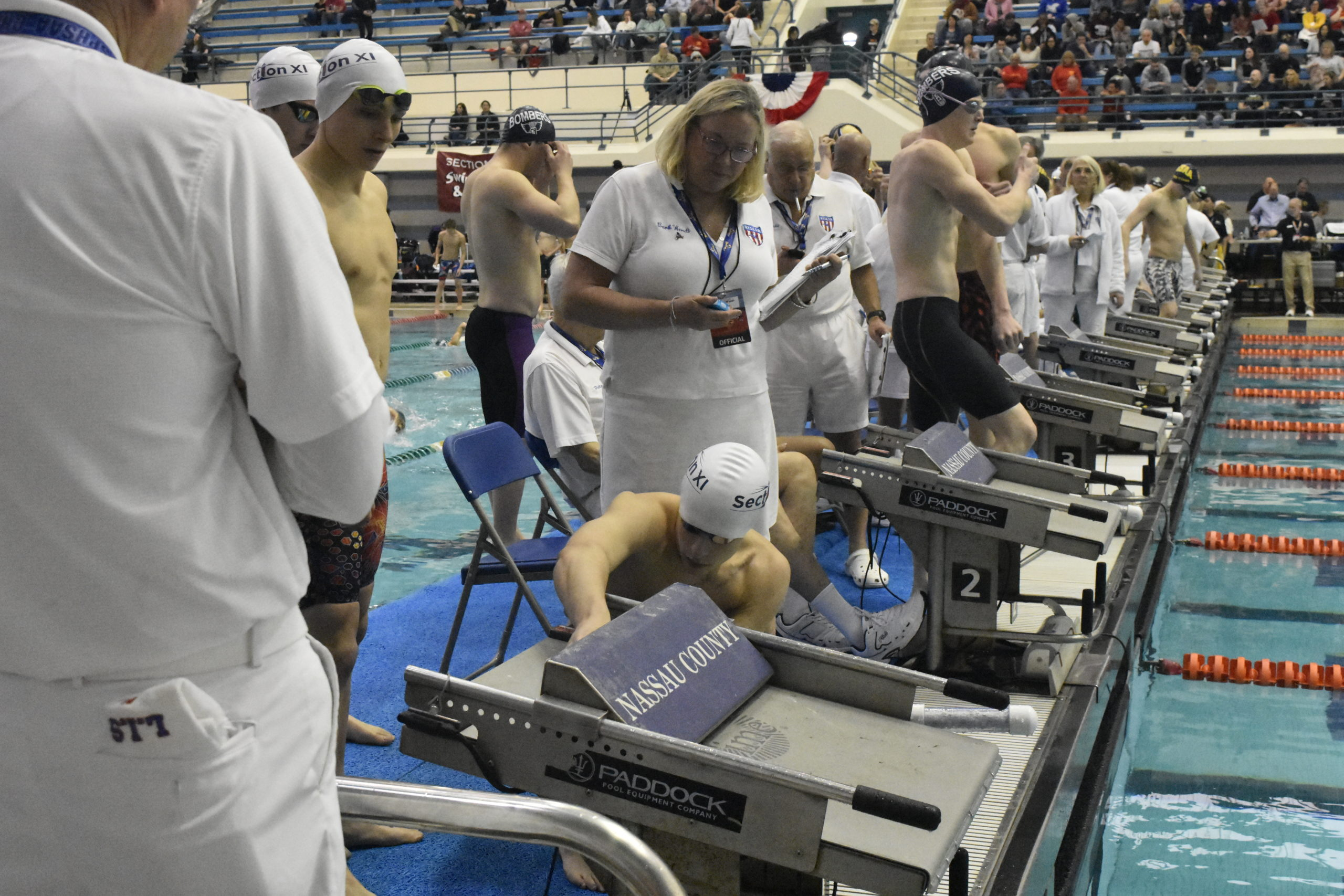 Colin Harrison makes sure everything is good to to go prior to the 200-yard freestyle relay.