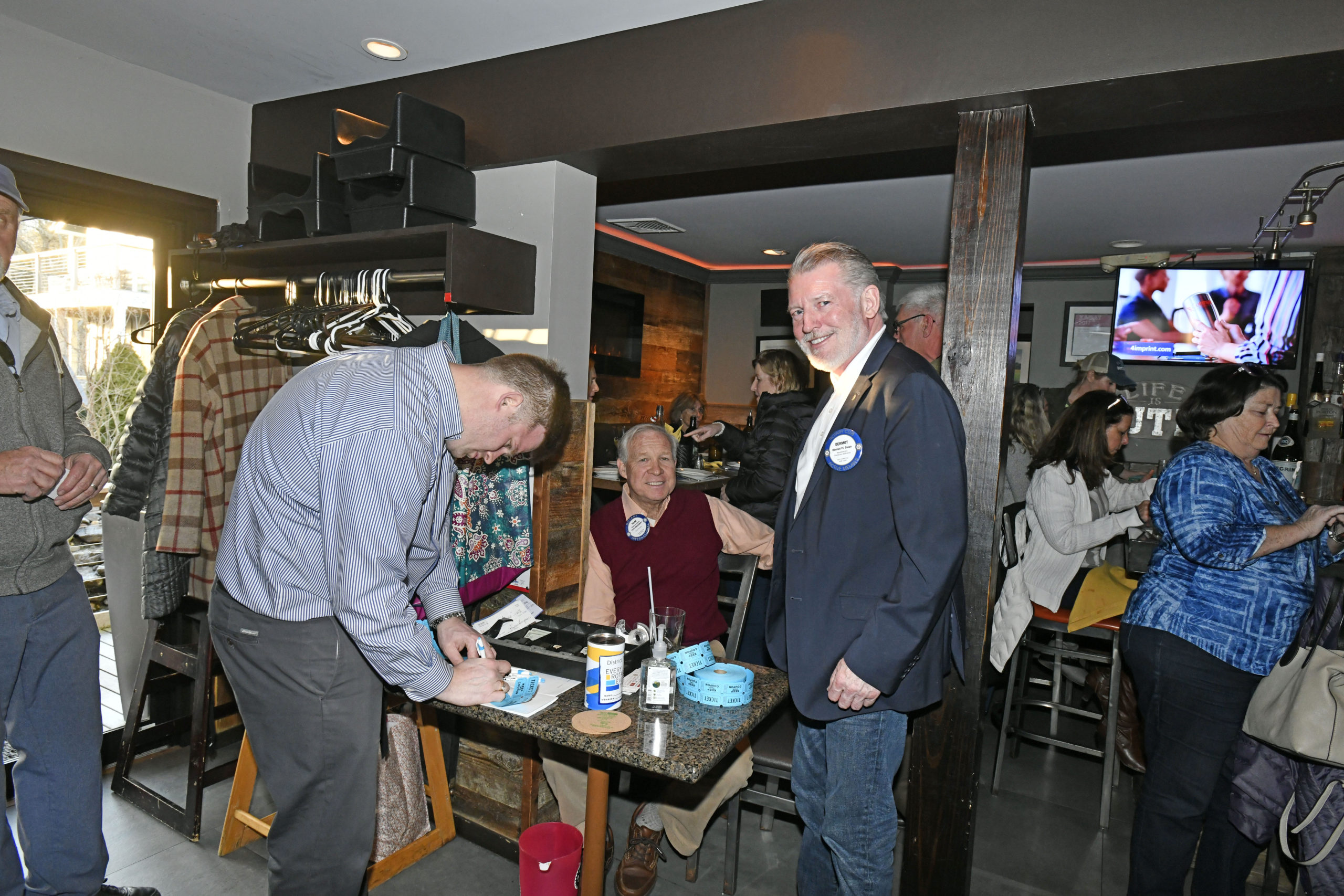 Southampton Rotarians Tom Guldi and Dermot Dolan welcome patrons to the the annual Southampton Rotary Club spaghetti dinner on Monday evening at the Edgewater Restaurant in Hampton Bays.  DANA SHAW