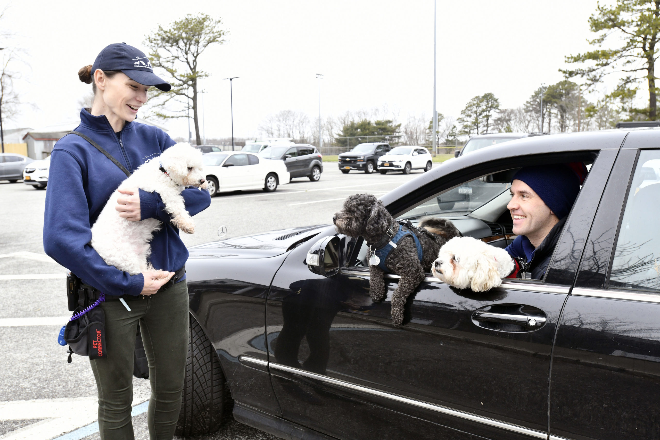 Tim Malone and his dogs meet with trainer Veronica Grzybowski and Gus Gus, a 10-year-old, poodle mix at The Southampton Animal Shelter on Friday as part of the roadside adoption/foster program.   DANA SHAW