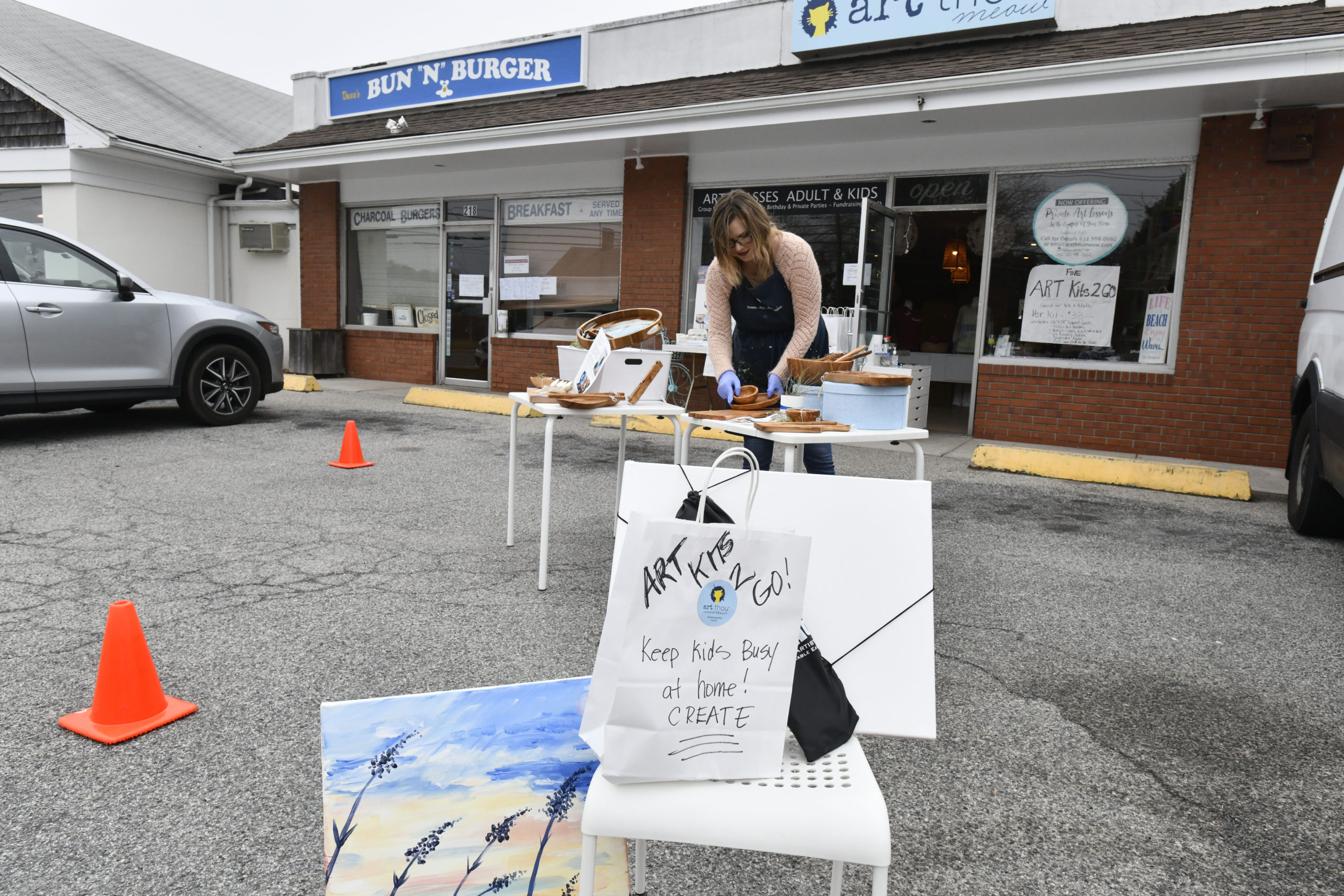 Jaime Booth of Art Thou Meow in Westhampton Beach was selling Art Kits 2 Go in front of her shop on Friday afternoon.   DANA SHAW