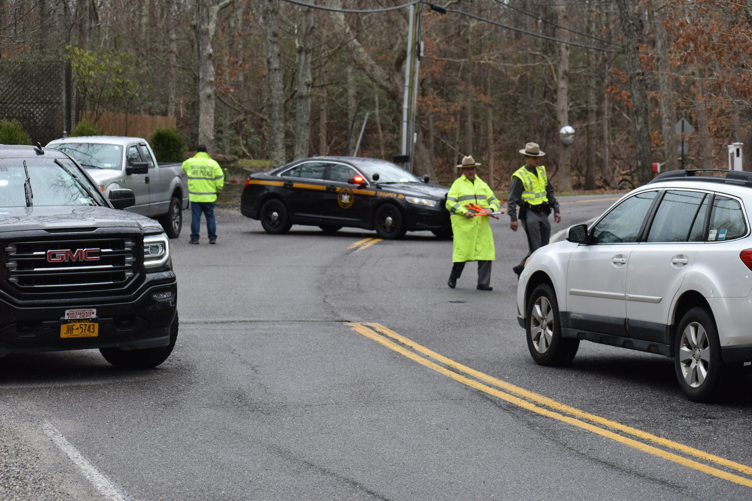 New York State troopers direct traffic around the site of a motorcycle accident on Deerfield Road between Noyac and Water Mill on Saturday.