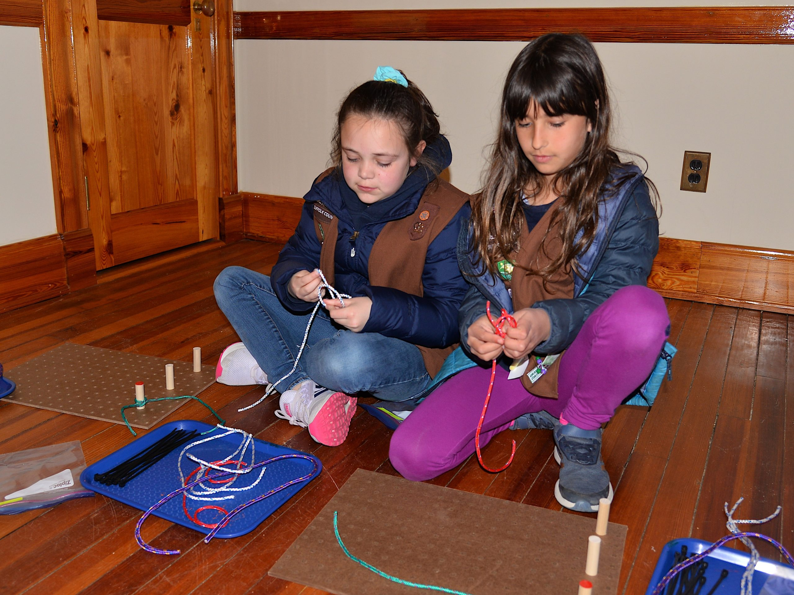 Girl Scouts, including Fallon Centalonza and Pai Bellenoue, learned how to tie knots on Friday at the Amagansett Lifesaving Station, with instructors Britton Bistrian and Stewart Close.