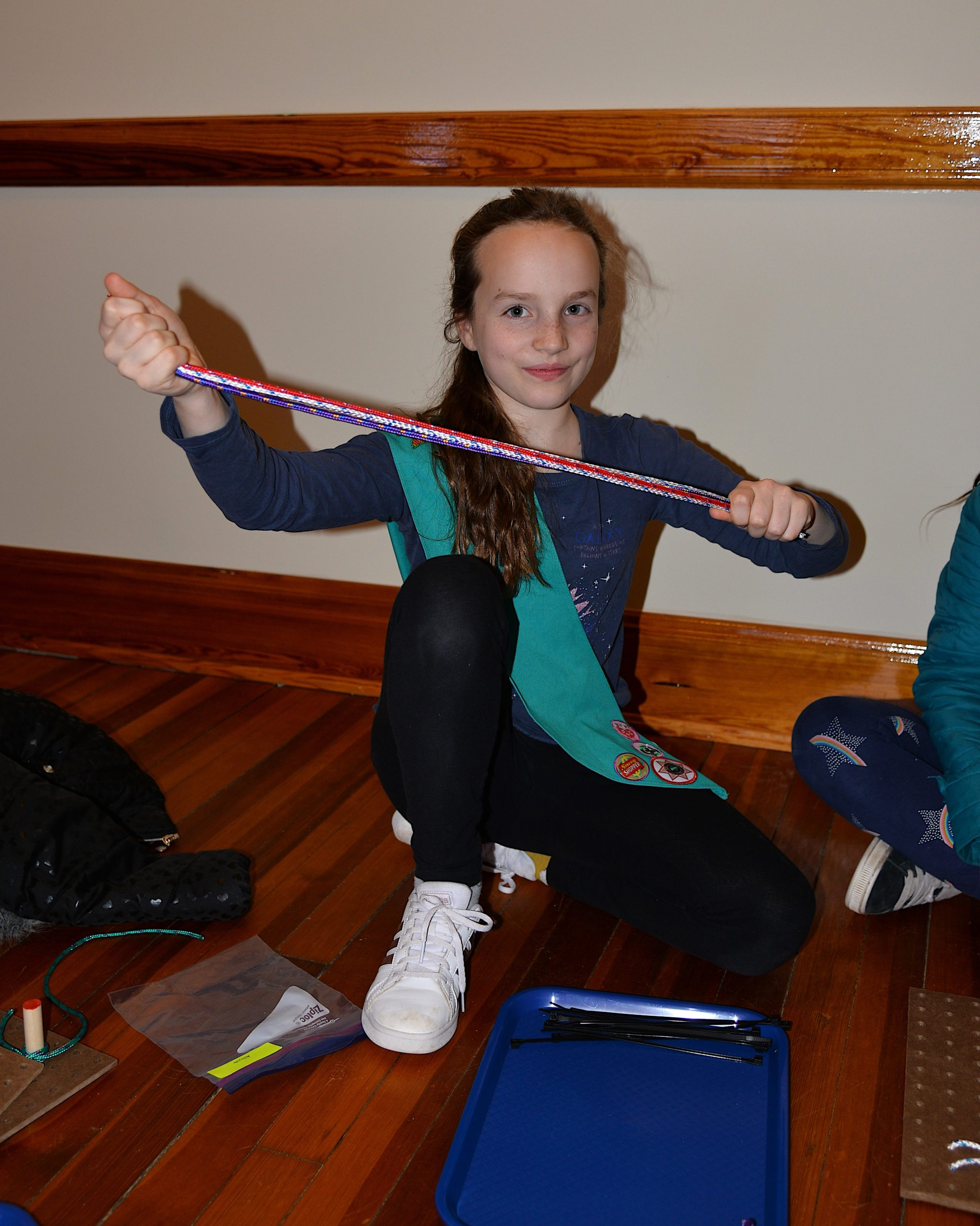 Girl Scouts, including Clemens Emptage, learned how to tie knots on Friday at the Amagansett Lifesaving Station, with instructors Britton Bistrian and Stewart Close.