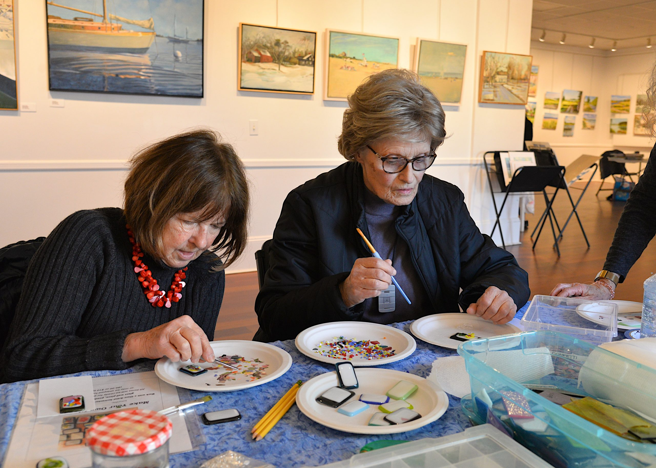 The Artists Alliance of East Hampton held an art exhibit at Ashawagh Hall this weekend, featuring then work of the Wednesday Group, Plein-Air artists using local scenery for inspiration There were also workshops in painting and glass fusion. Ursula Thomas and Annie Loris try their hand at learning glass fusing techniques. KYRIL BROMLEY