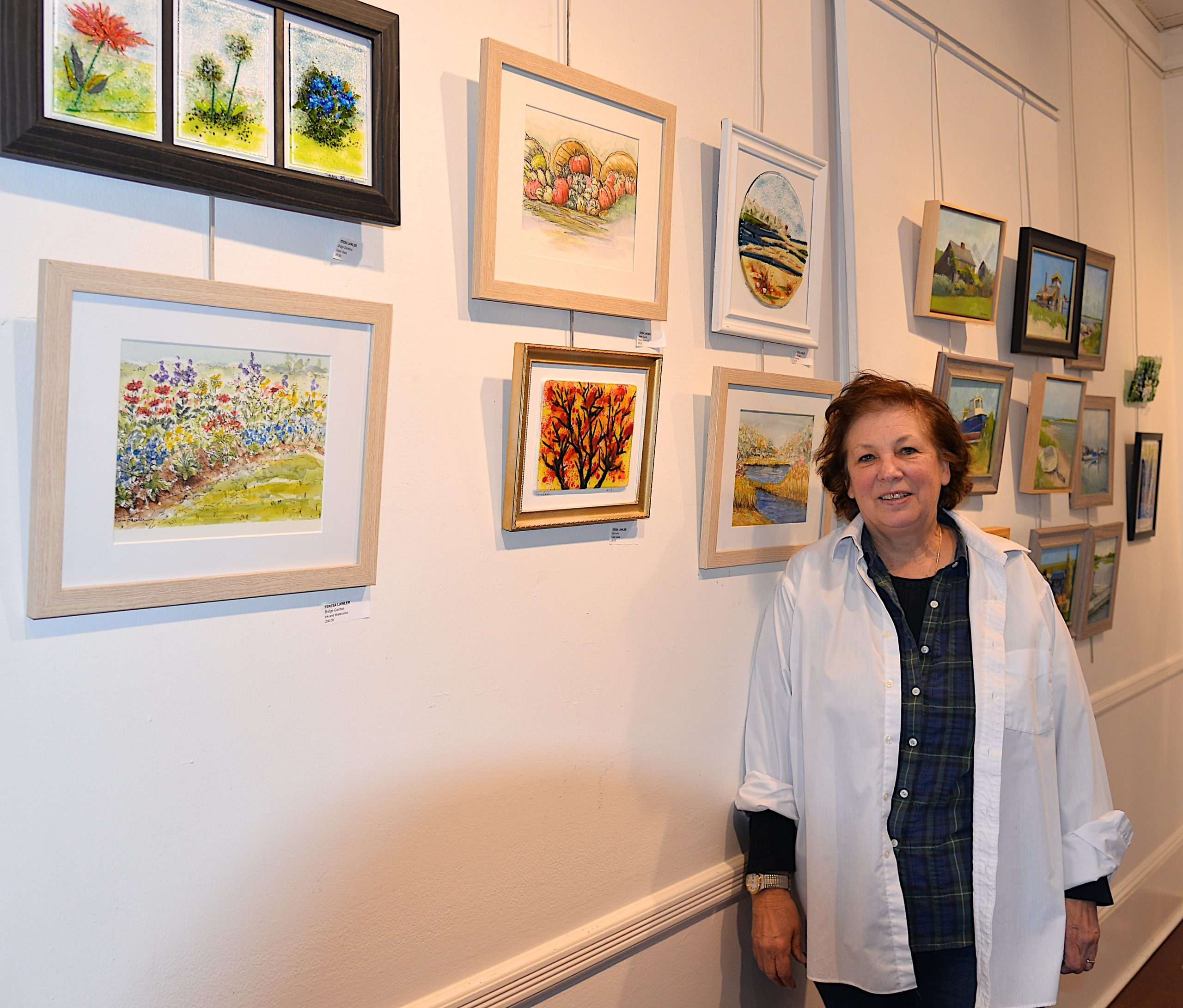 The Artists Alliance of East Hampton held an art exhibit at Ashawagh Hall this weekend, featuring then work of the Wednesday Group, Plein-Air artists using local scenery for inspiration There were also workshops in painting and glass fusion. Teresa Lawler with her artwork.  KYRIL BROMLEY