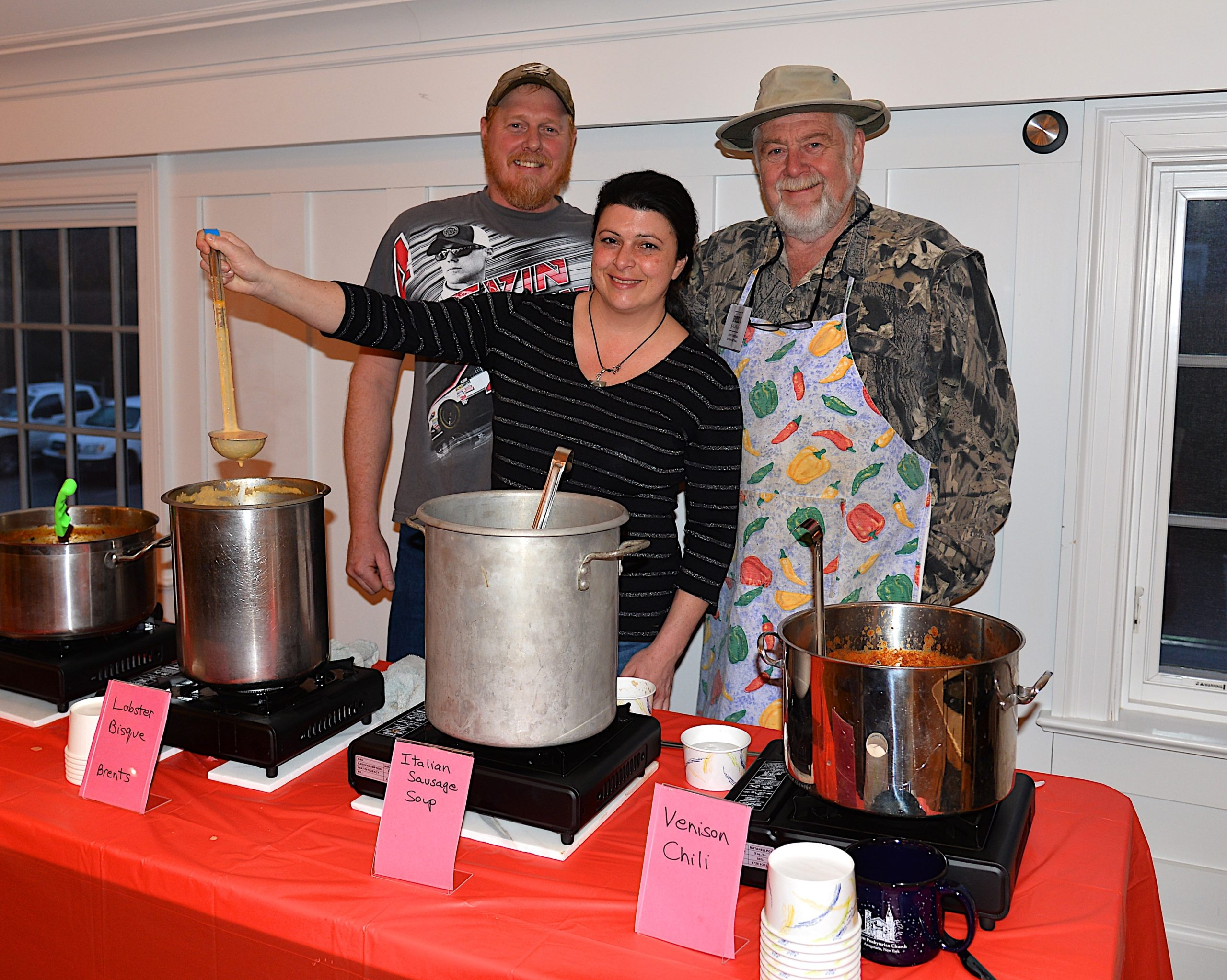 Mark and Diane Hallock, and Terry O'Riordan ready to serve at the Amagansett Presbyterian Church's Soup and Chili dinner on Saturday. KYRIL BROMLEY