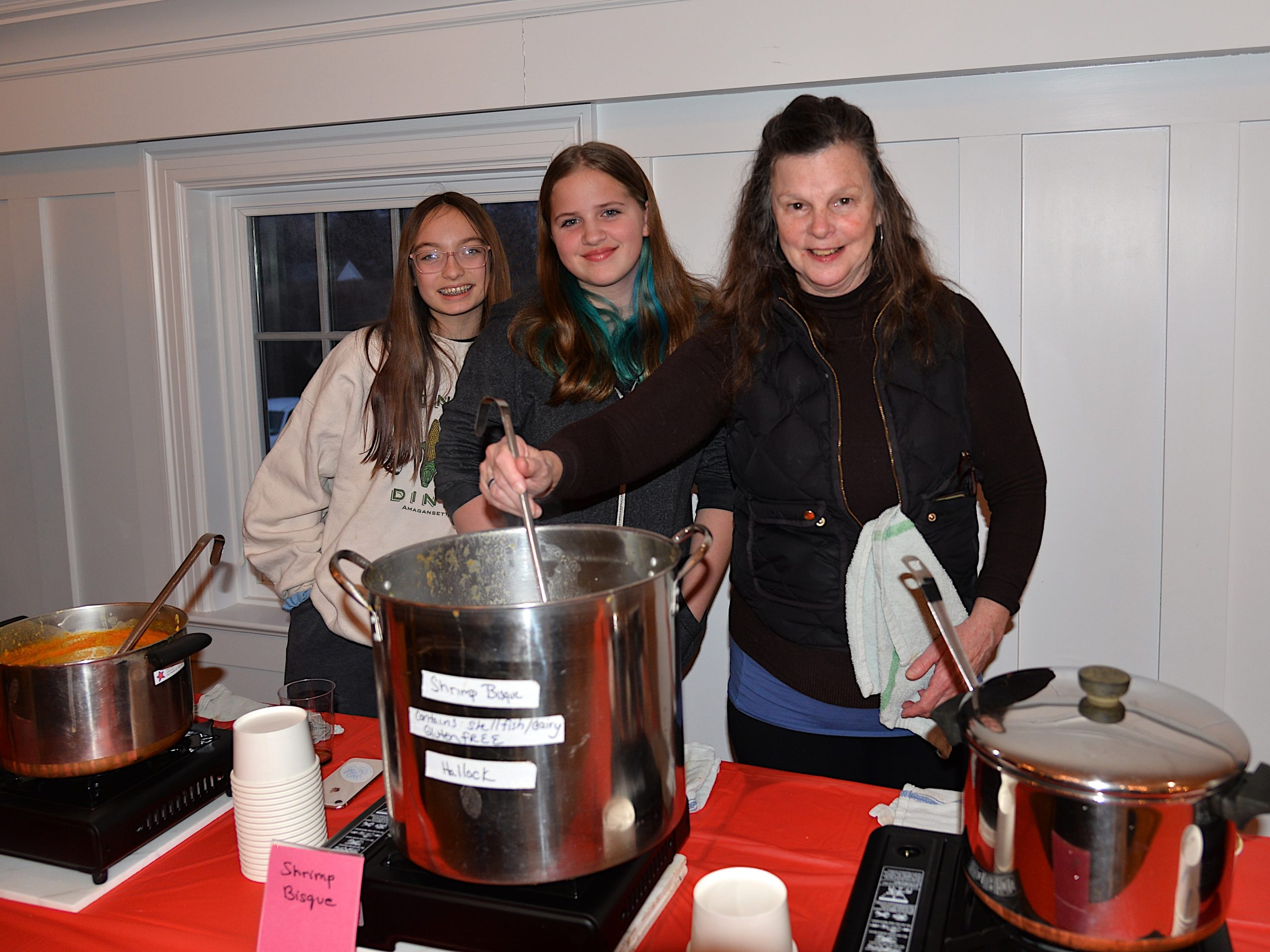 The deacons of the Amagansett Presbyterian Church hosted a Soup and Chili dinner on Saturday. Ea Feleppa, Emma Hallock and Betsy Martin are ready to serve it up. KYRIL BROMLEY