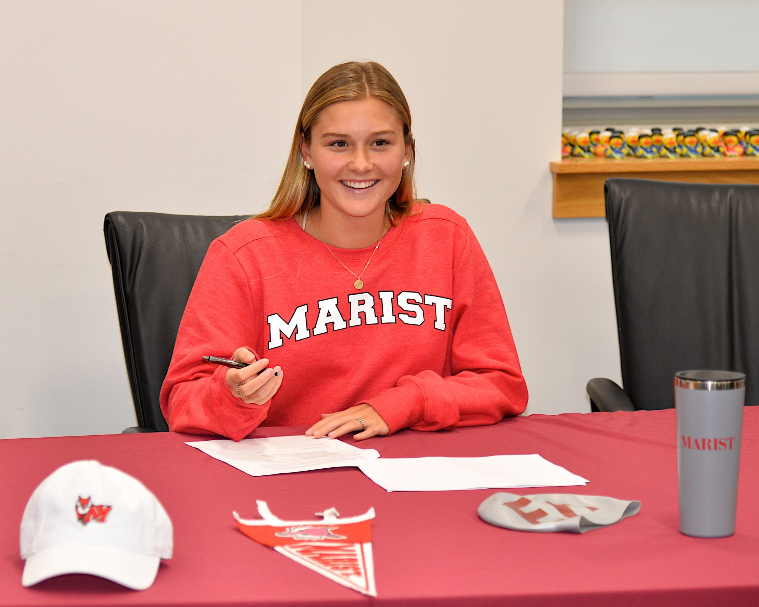 East Hampton senior Sophia Swanson made it official on Tuesday afternoon, committing to Marist College to continue her swim career.