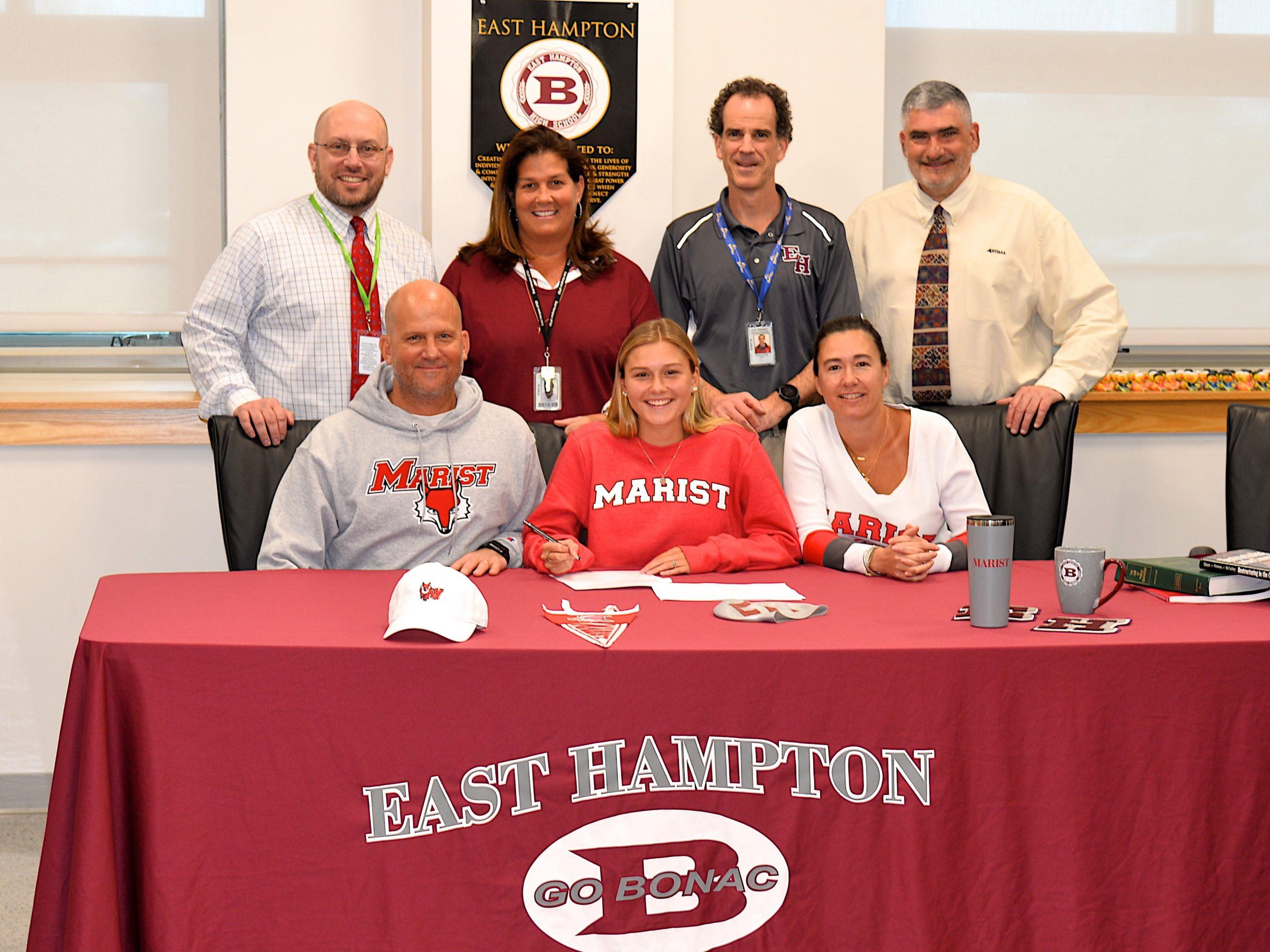 East Hampton High School principal Adam Fine, at top left, with Simone Ritz, swim coach Craig Brierley and athletic director Joe Vasile-Cozzo with Richard, Sophia and Carolina Swanson.