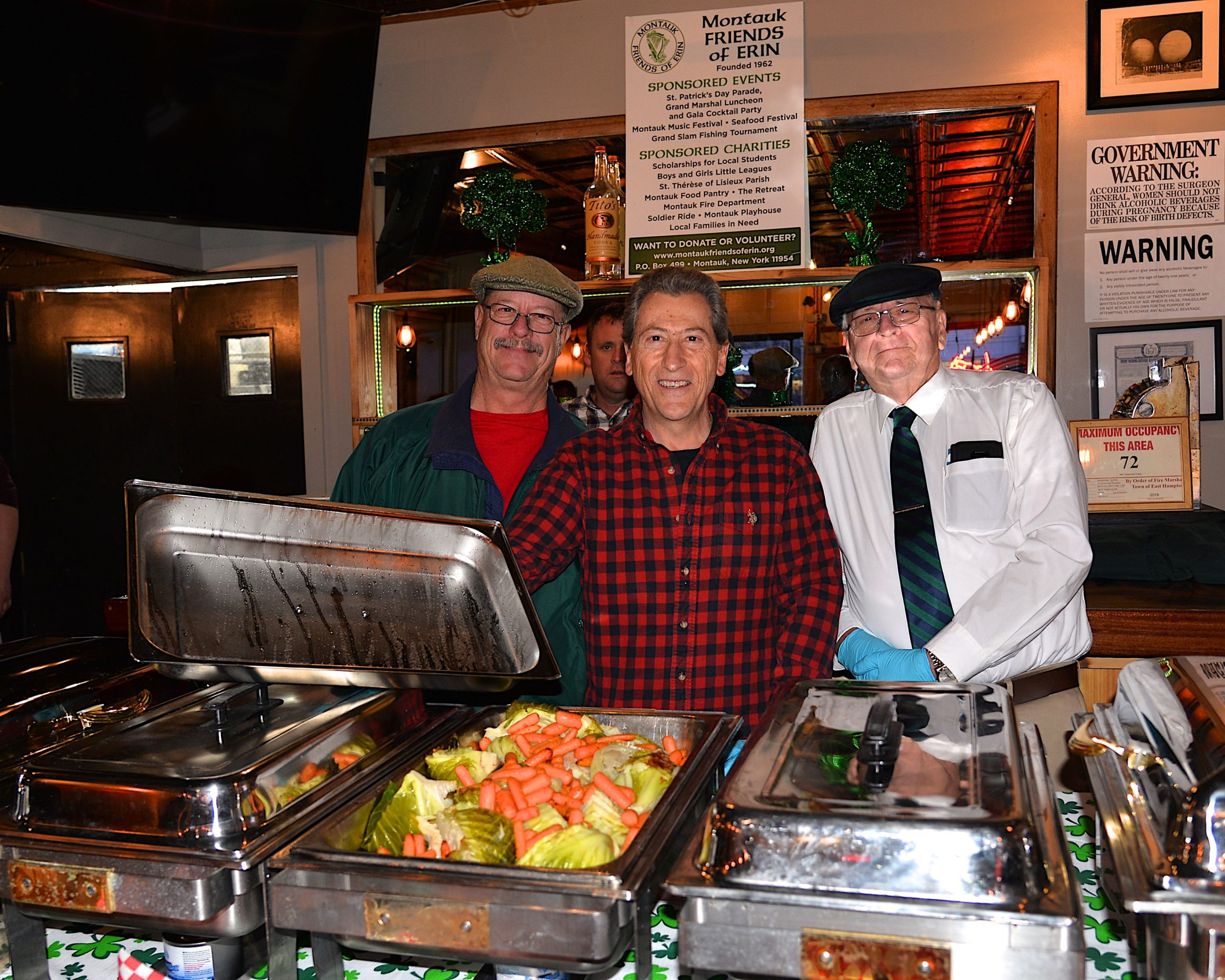 The Montauk Friends Of Erin held a corned beef and cabbage dinner at Shagwong Tavern on Saturday, at which Joe Bloecker, Paul Monte and Cliff Johnson were helping out. KYRIL BROMLEY