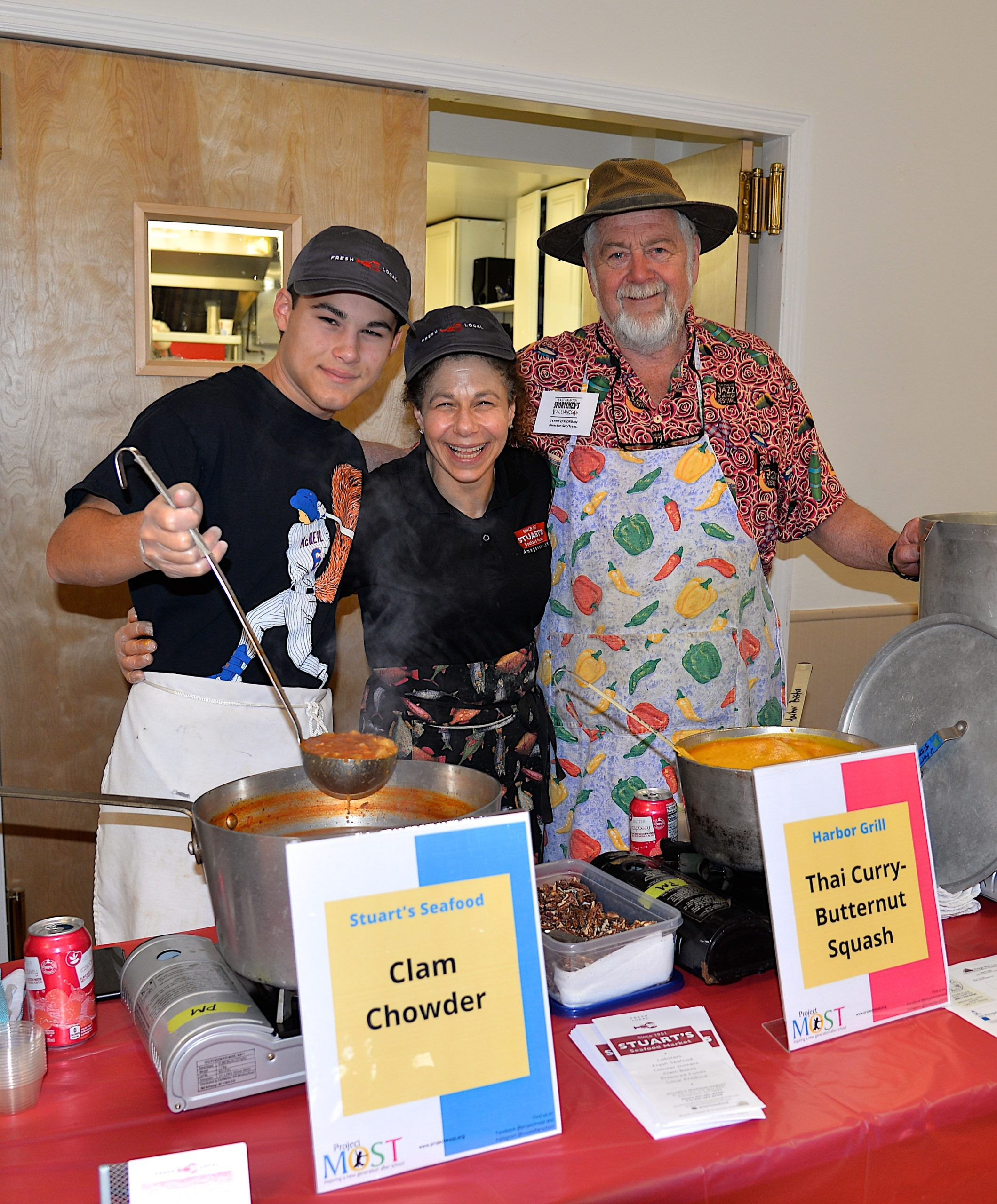 Empty Bowls, a fundraiser for Project Most, with soups from local chefs and restaurants took place at the Amagansett American Legion hall on Sunday. Dante and Charlotte Sasso, and  Terry O'Riordan serving up their soup. KYRIL BROMLEY