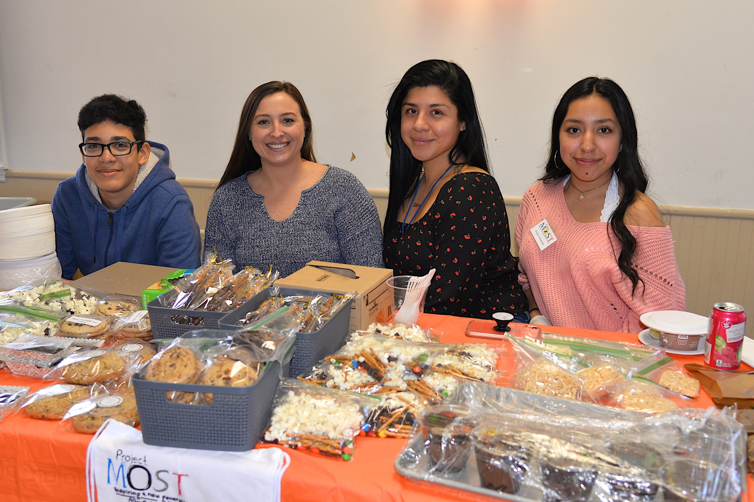 Empty Bowls, a fundraiser for Project Most, with soups from local chefs and restaurants took place at the Amagansett American Legion hall on Sunday. Volunteering at the baked goods table, from left, Aaron Jimenez, Melissa Anderson, Malany Perez and Mariser Gallegos. KYRIL BROMLEY