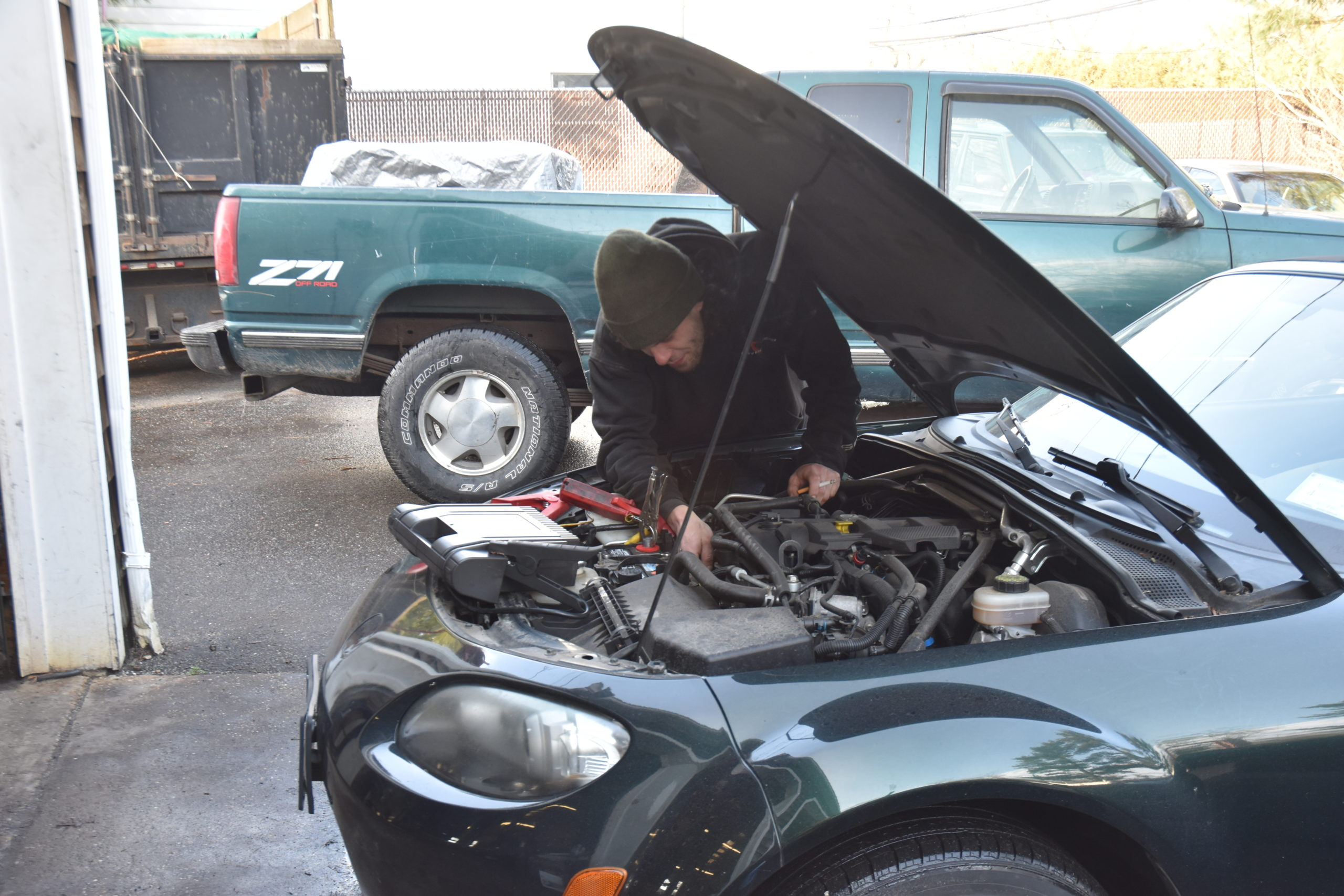 Mechanic Brian Damark worked on a car at East Hampton Auto Friday afternoon. STEPHEN J. KOTZ