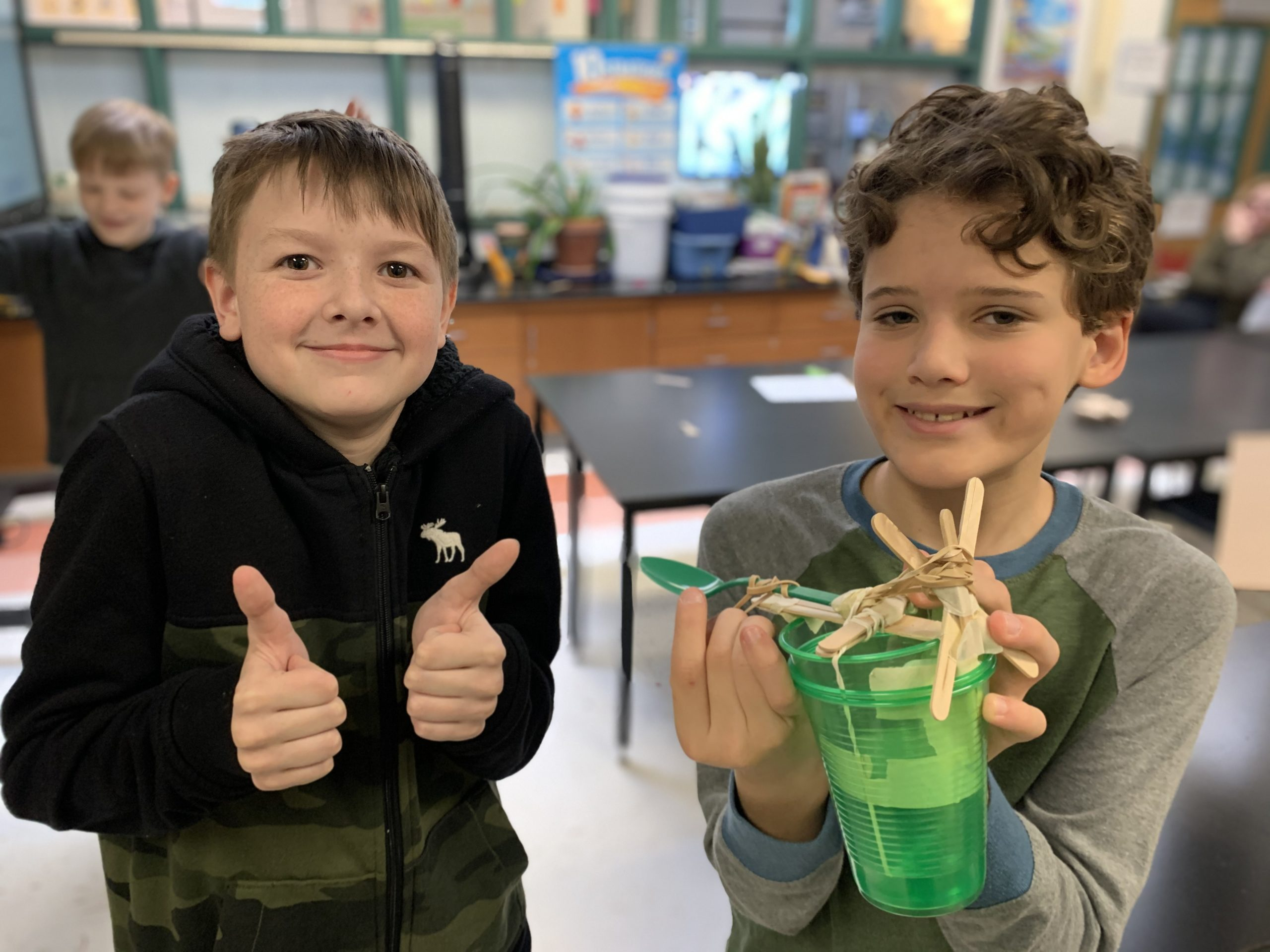 East Quogue Elementary School sixth graders are exploring how catapults changed warfare in ancient Greece by engineering their own catapults with a limited set of supplies.  Ari Firestein and Aidan Judd, right, with their design.