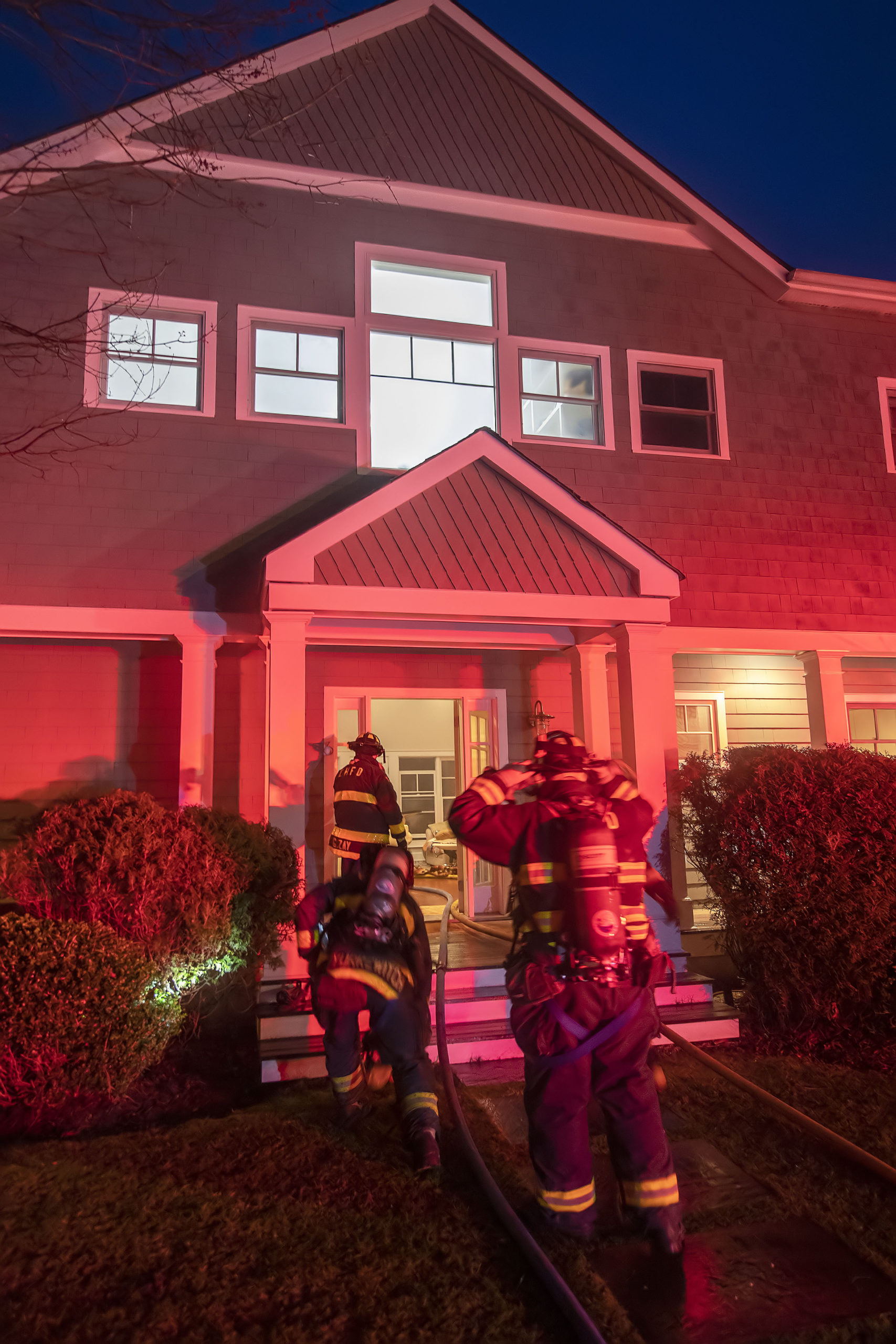 East Hampton firefighters were called to a house fire on Liano Drive in Wainscott Sunday night. MICHAEL HELLER