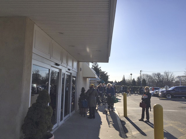 Seniors wait in line during special shopping hours at the Amagansett IGA.  KITTY MERRILL
