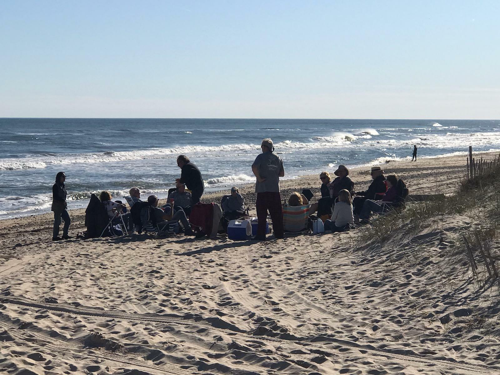 An exasperated East Hampton Town Supervisor Peter Van Scoyoc shared this shot of over a dozen people at a beach party on Ditch Plains Beach in Montauk Friday evening.