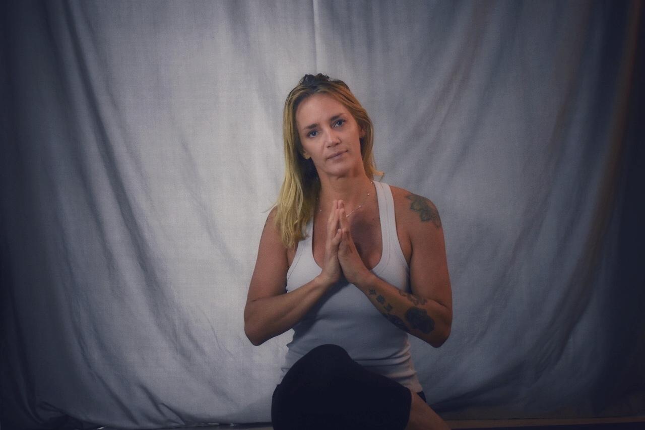 Allison Burke leads an online yoga class.