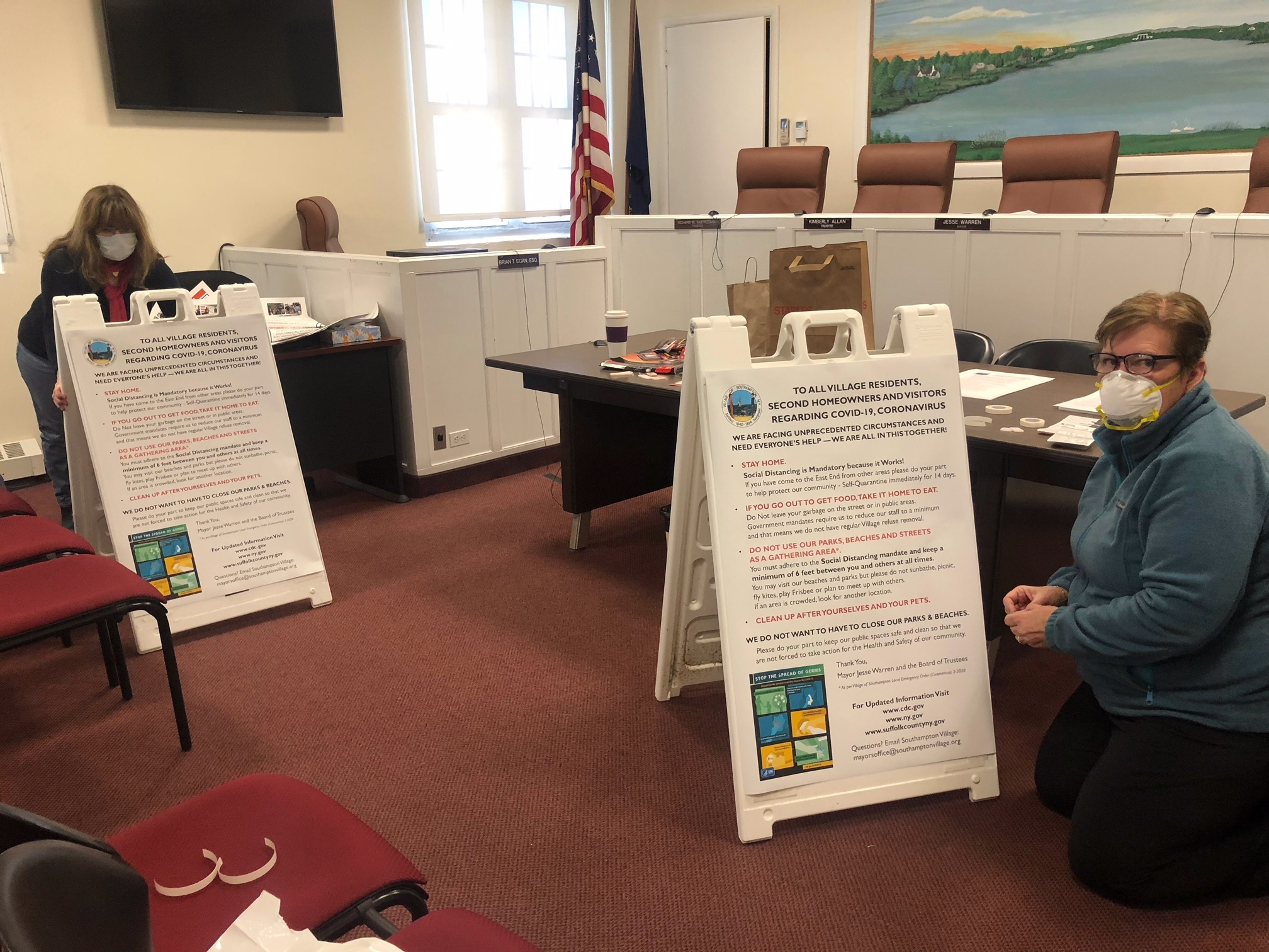 In Southampton Village, Julie Fitzgerald and Patricia Lederman worked on signs offering COVID-19 warnings and advice.