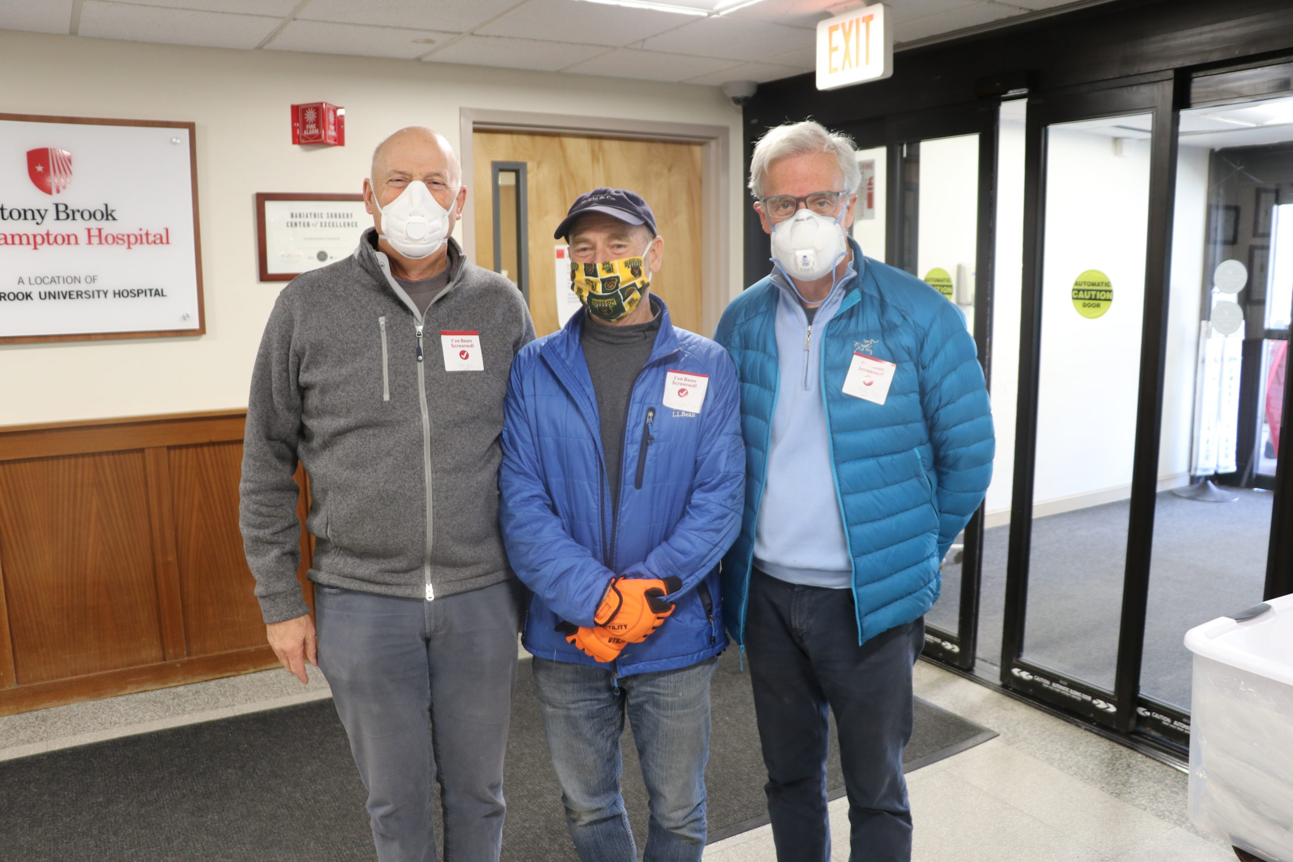 Ken Wright, Chair, Southampton Hospital Association, Philip Alford of Wright & Company Construction, and Michael Reilly, Reilly Architectural; who, along with over a hundred East End volunteers, were instrumental in producing and hand-assembling thousands of protective isolation gowns for Stony Brook Southampton Hospital.