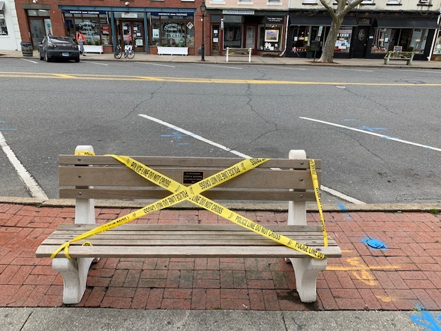 Police in Sag Harbor Village taped off benches in an effort to get people to comply with New York PAUSE. COURTESY SHPD