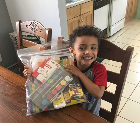 Dylan of Riverhead is so excited to receive a CareKit.