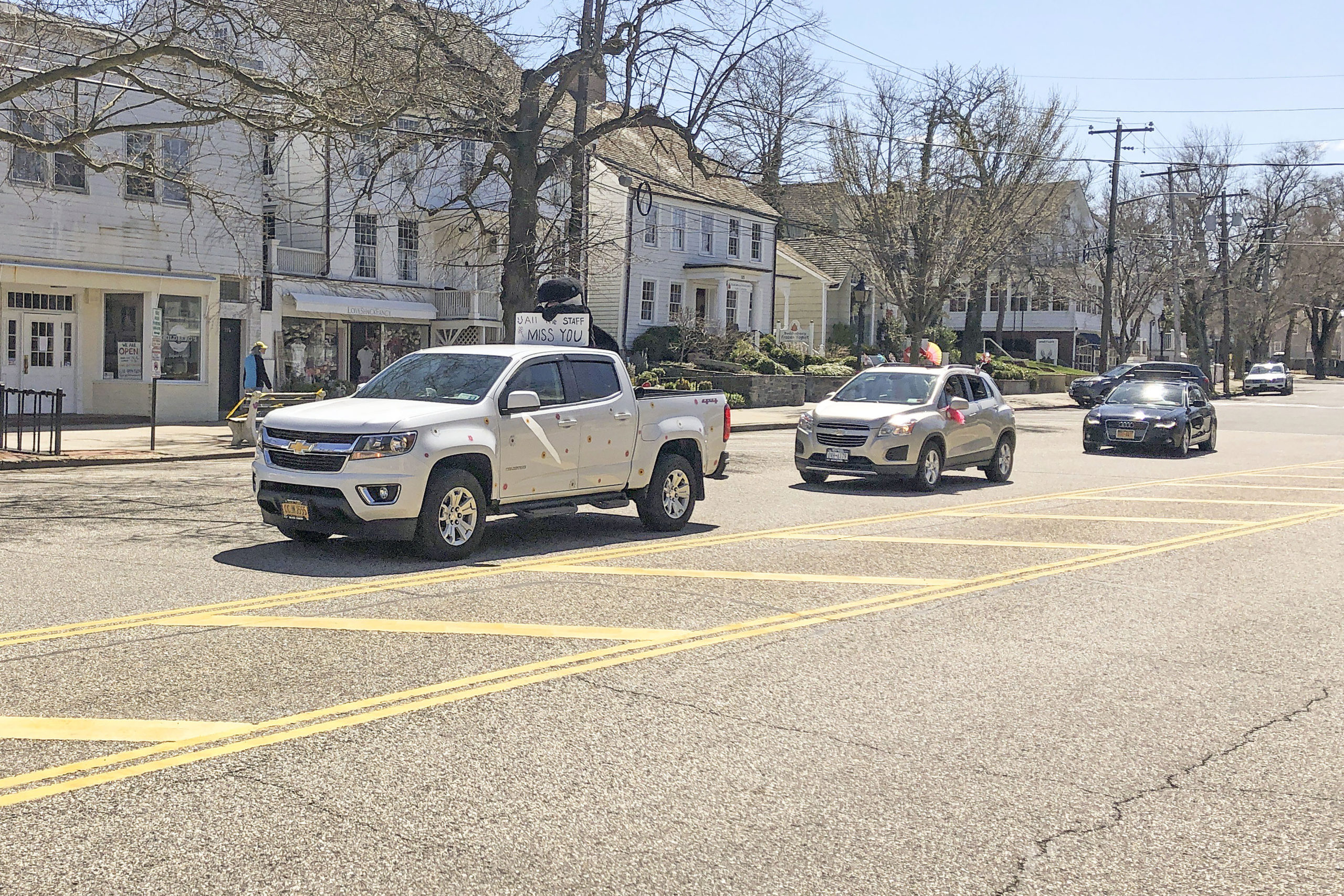 Sag Harbor Elementary School teacher Cathy Carlozzi led a small, impromptu parade down Main Street in Sag Harbor on Monday with a special message for students: