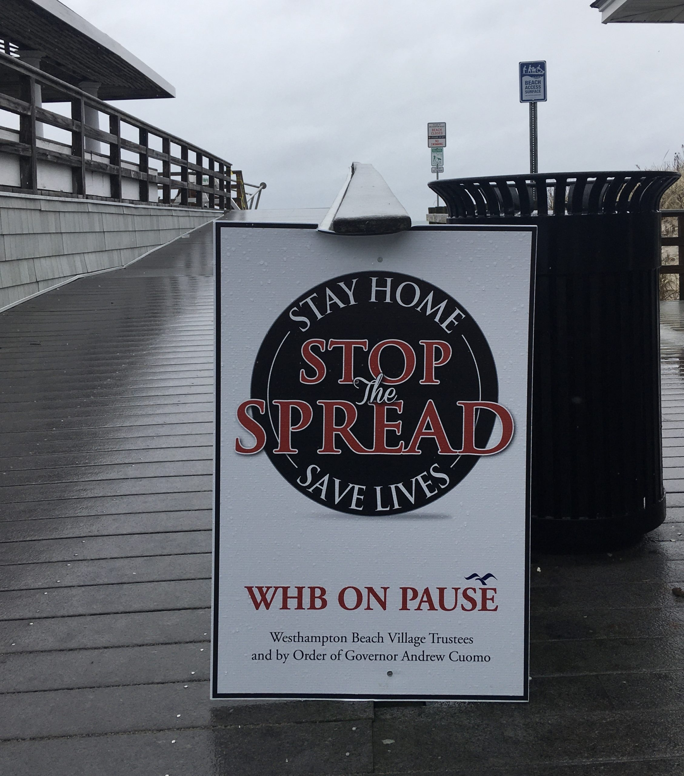 In the Village of Westhampton Beach, signs encourage visitors to the beaches and parks to comply with the New York PAUSE order.