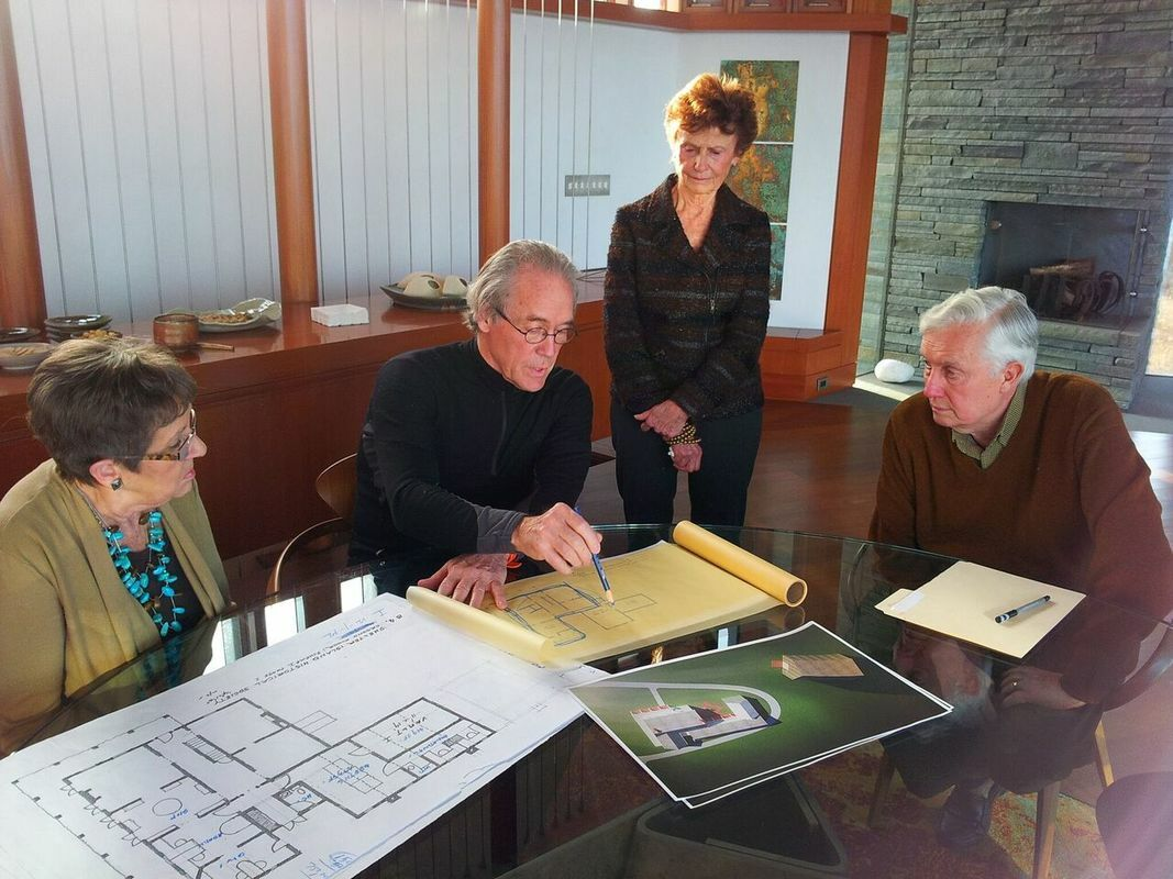 William Pederson reviews plans with members of the Shelter Island Historical Society.