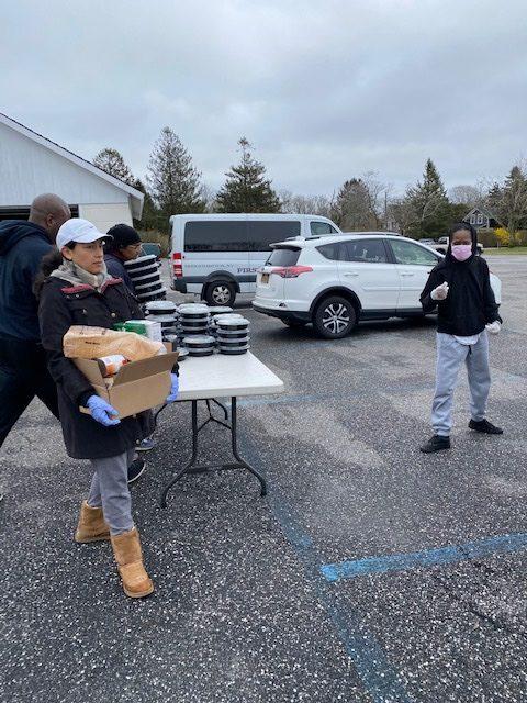 Volunteers prepare to distribute food. COURTESY HAMPTONS ART CAMP