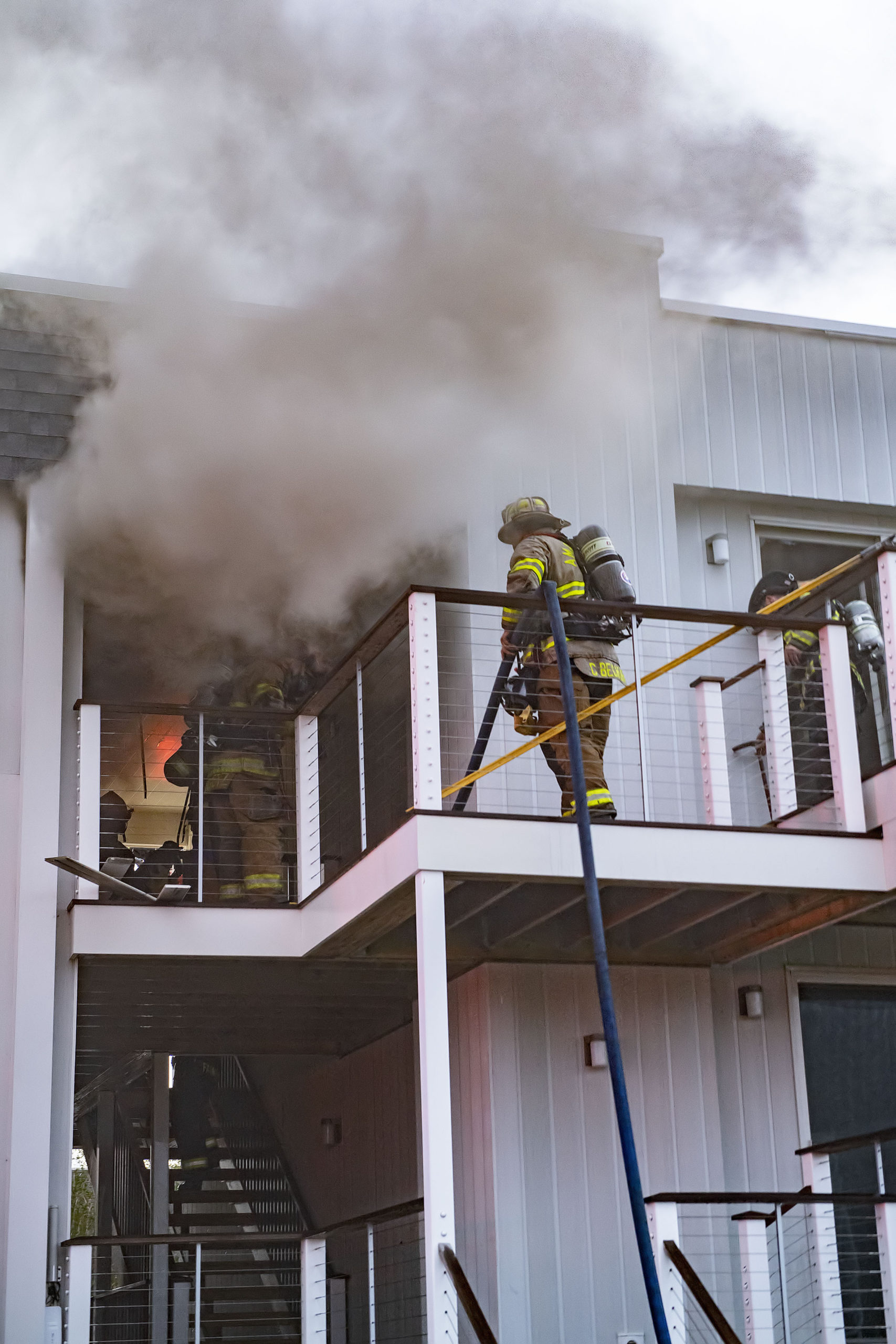 Members of the Montauk, Amagansett and East Hampton Fire Departments battled a working fire at the Atlantic Bluffs Condominiums at 707 Old Montauk Highway on Saturday night.  MICHAEL HELLER