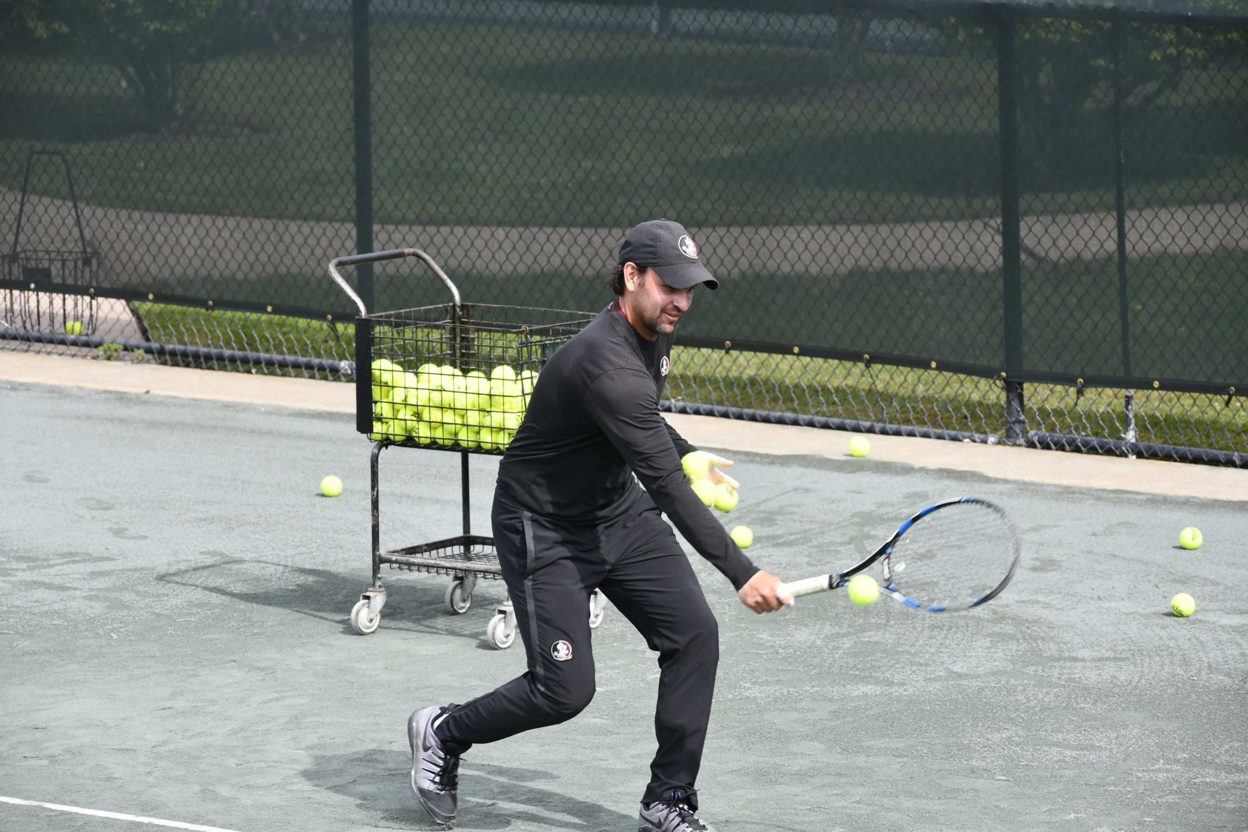 Tennis instuctor Matej Zlatkovic works with a student at East Hampton Indoor Tennis on Saturday morning.  DANA SHAW