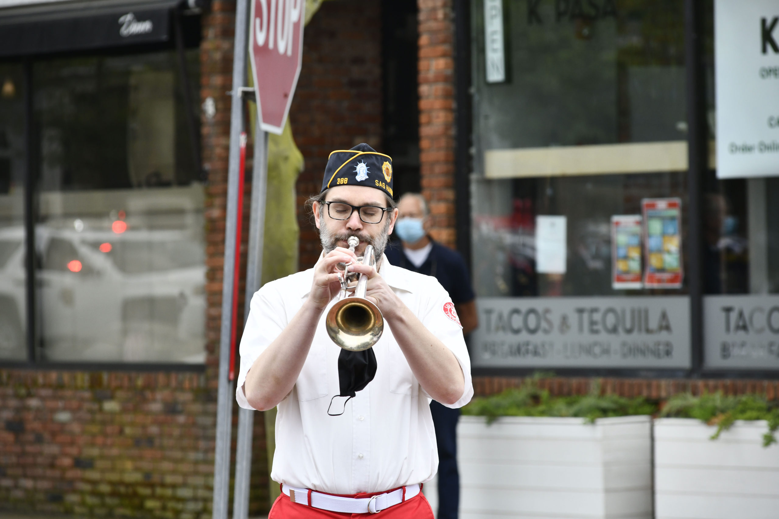 Alex Huberty plays Taps during Memorial Day observances in Sag Harbor on Monday.