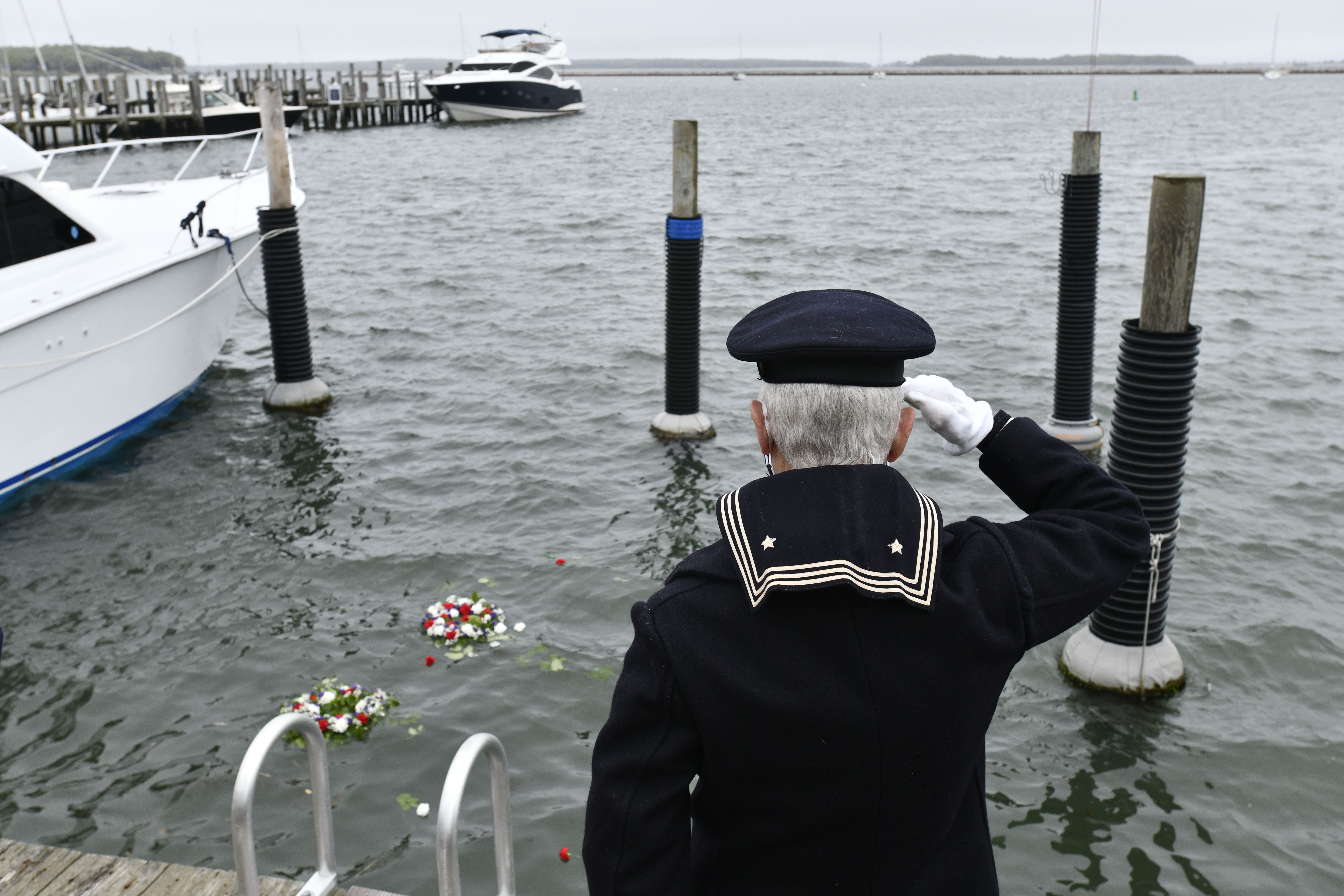 John Capello salutes during Memorial Day observances in Sag Harbor on Monday.