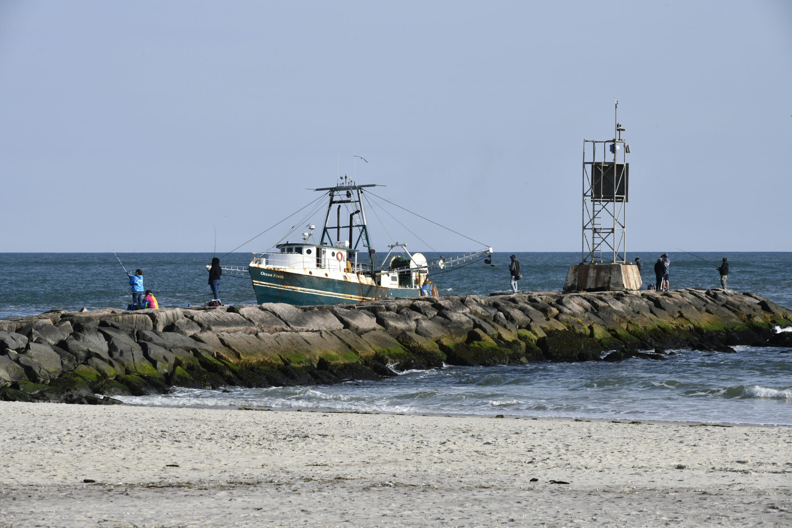 Fishermen head into Shinnecock inlet in Hampton Bays.  DANA SHAW