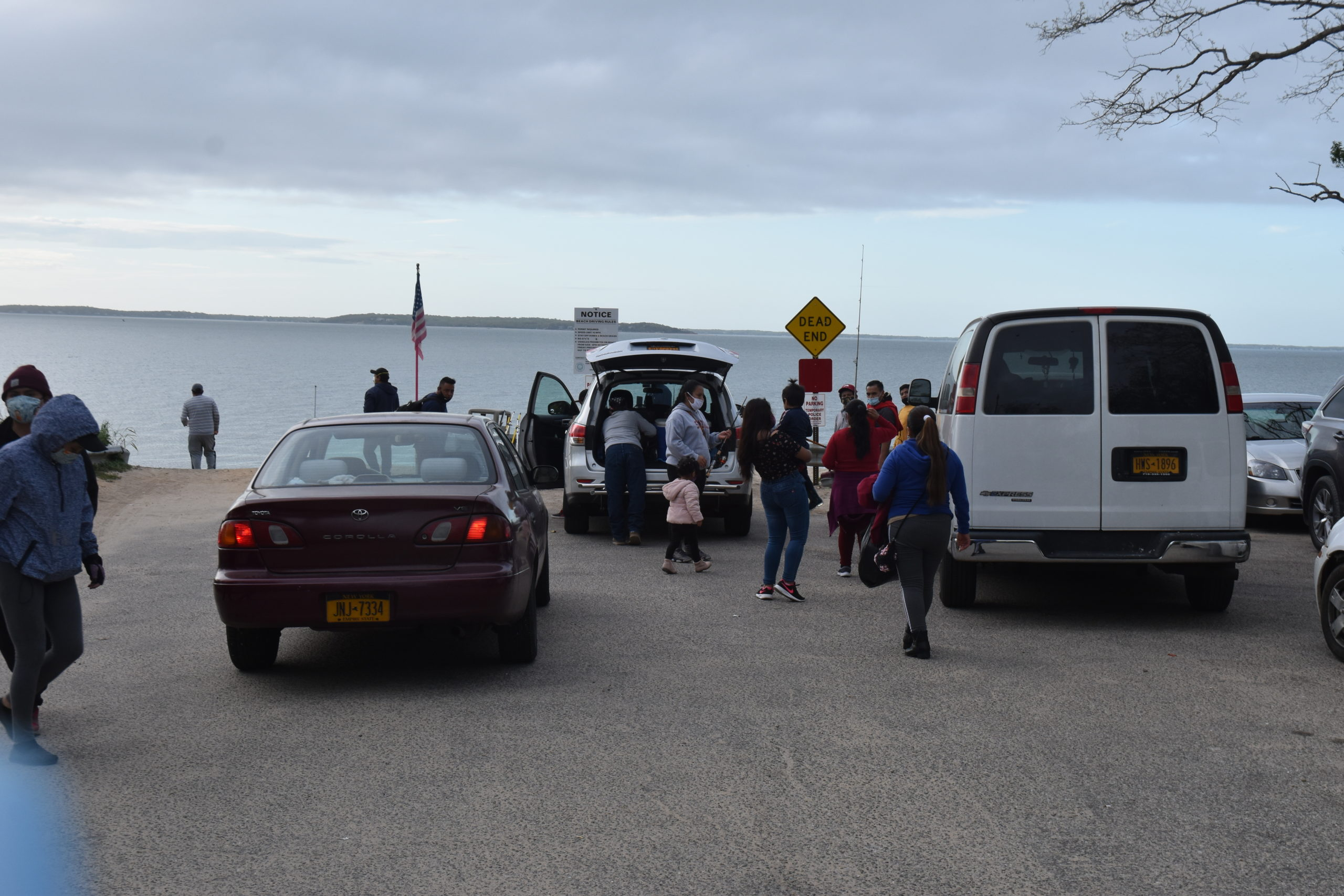 Families, many of whom said they drove out from Queens and Brooklyn, arrive at North Sea Beach Friday night. STEPHEN J. KOTZ