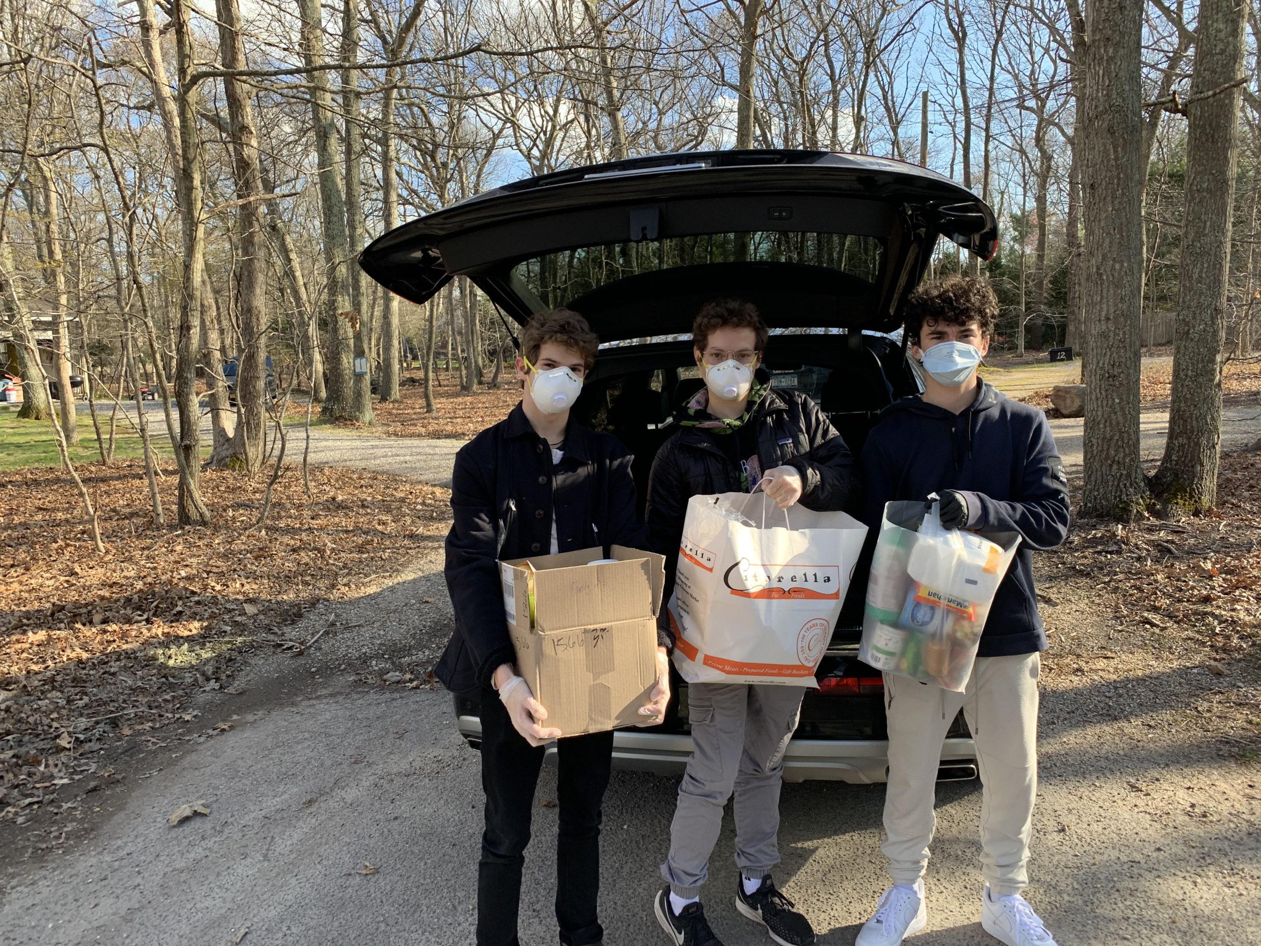 Ben Gleeman, Jonah Gleeman, and Ryan Spiegel, the founders of Doorstep Donations, with a recent pickup. COURTESY RYAN SPIEGEL