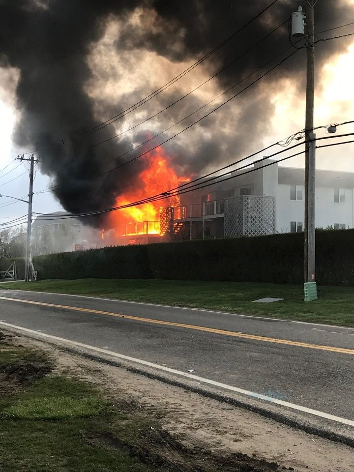 Fire rips through the Atlantic Bluffs complex on Old Montauk Highway in Montauk shortly before fire fighters arrive on the scene Saturday evening.