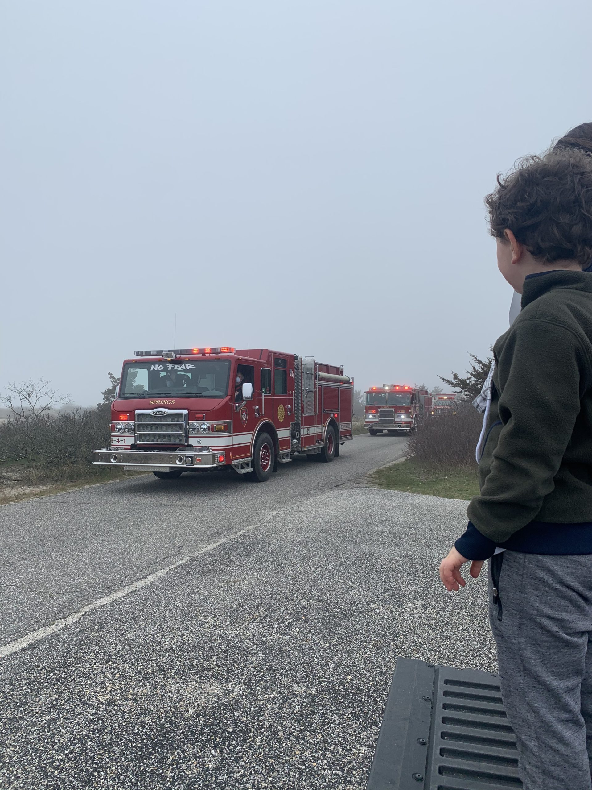 Volunteers with the Springs Fire Department lead a Spirit Drive at Maidstone Beach where students and families were encouraged to maintain social distance while waving to teachers and administrators.