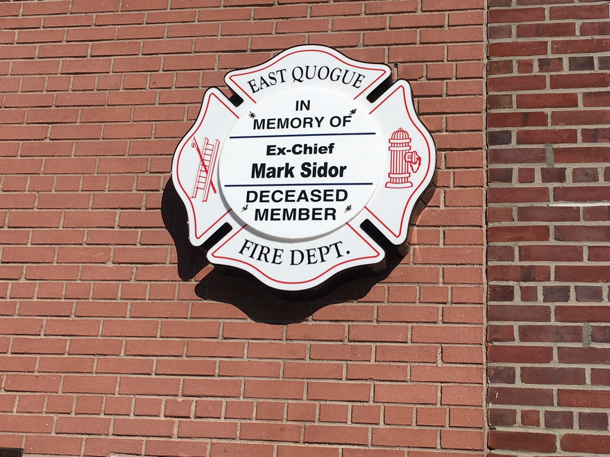 The placque marks Mark Sidor's service with the East Quogue Fire Department.  LORI SIDOR
