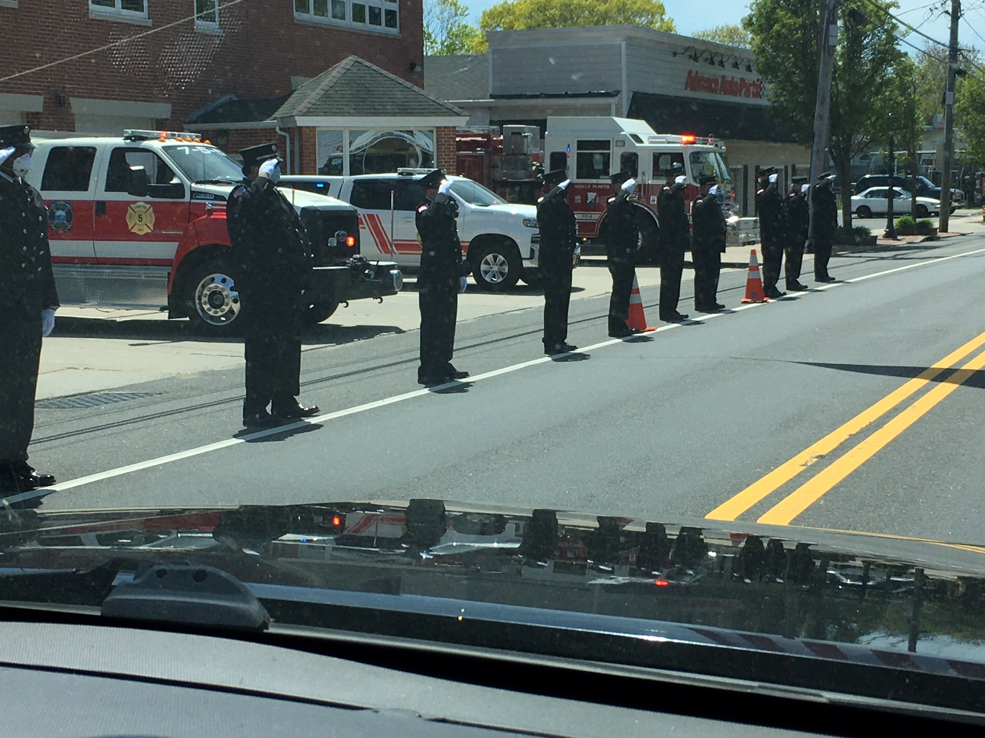 Firefighters saluted the funeral porcession as it passed. LORI SIDOR
