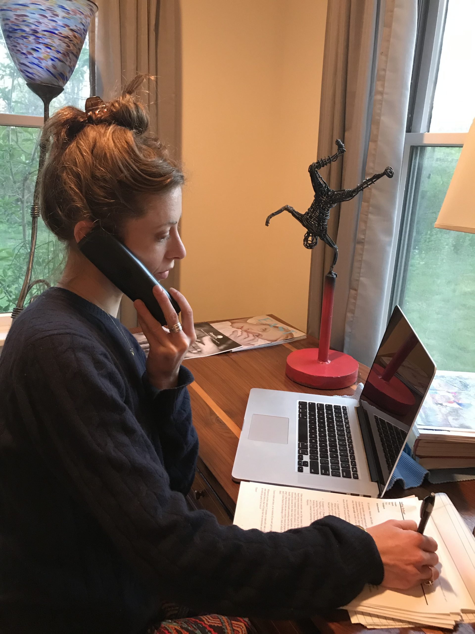 Julia, a volunteer for The Retreat, answers a call on the 24-hour emergency hotline.