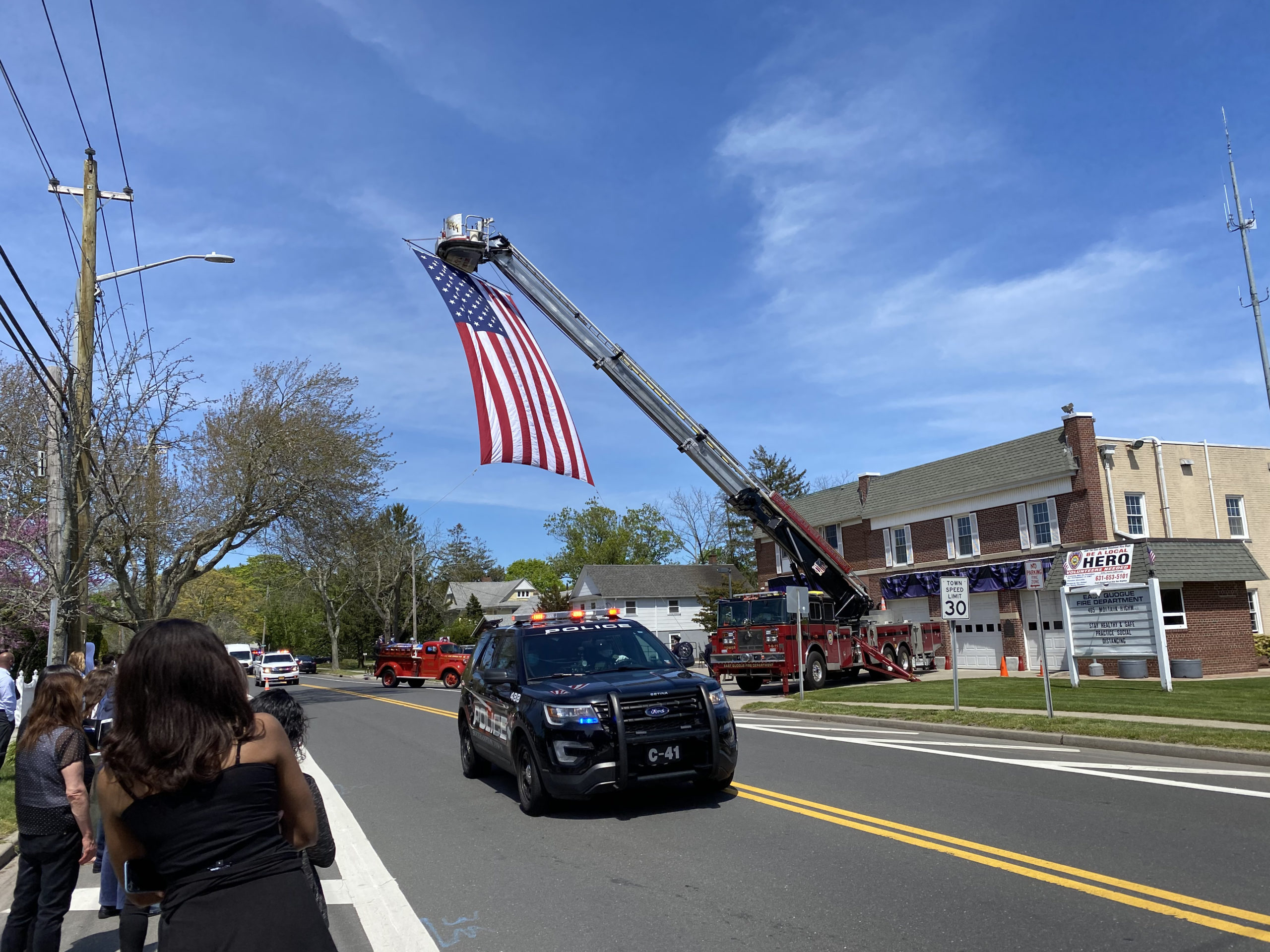 Montauk Highway was lined with people and fire and rescue trucks from all over the East End for the procession and service for Mark Sidor at the East Quogue Firehouse on Saturday afternoon.  DANA SHAW