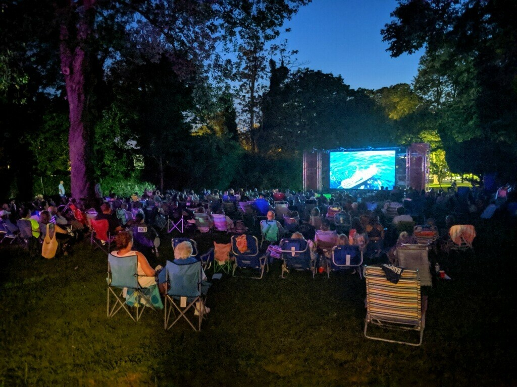 An outdoor film being screened at Southampton Arts Center last summer.