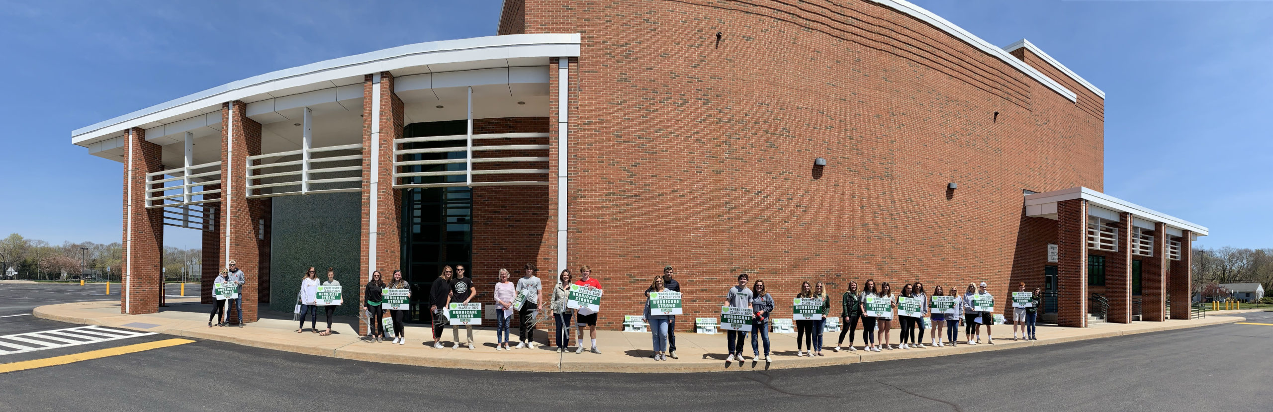 """Parents and seniors teamed up on April 25 to pay tribute to the Westhampton Beach High School Class of 2020 by delivering 224 green and white graduation lawn signs bearing the words """"Hurricane Strong.""""    COURTESY WESTHAMPTON BEACH SCHOOL DISTRICT"""