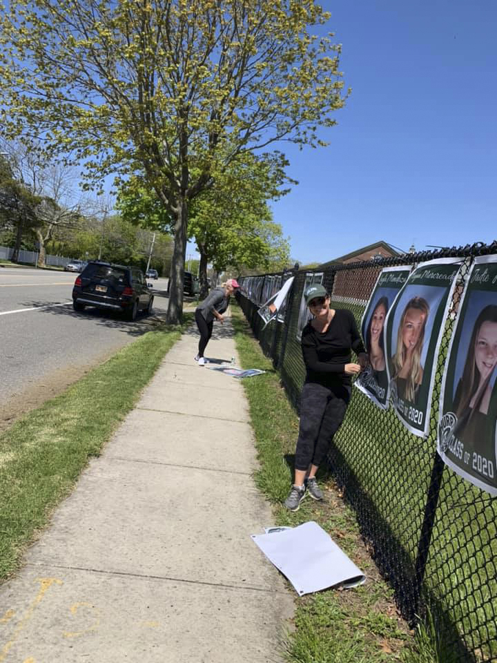The Westhampton Beach High School Class of 2020 is being recognized with giant posters that adorn the fence along Mill Road in Westhampton Beach.  COURTESY WESTHAMPTON BEACH SCHOOL DISTRICT