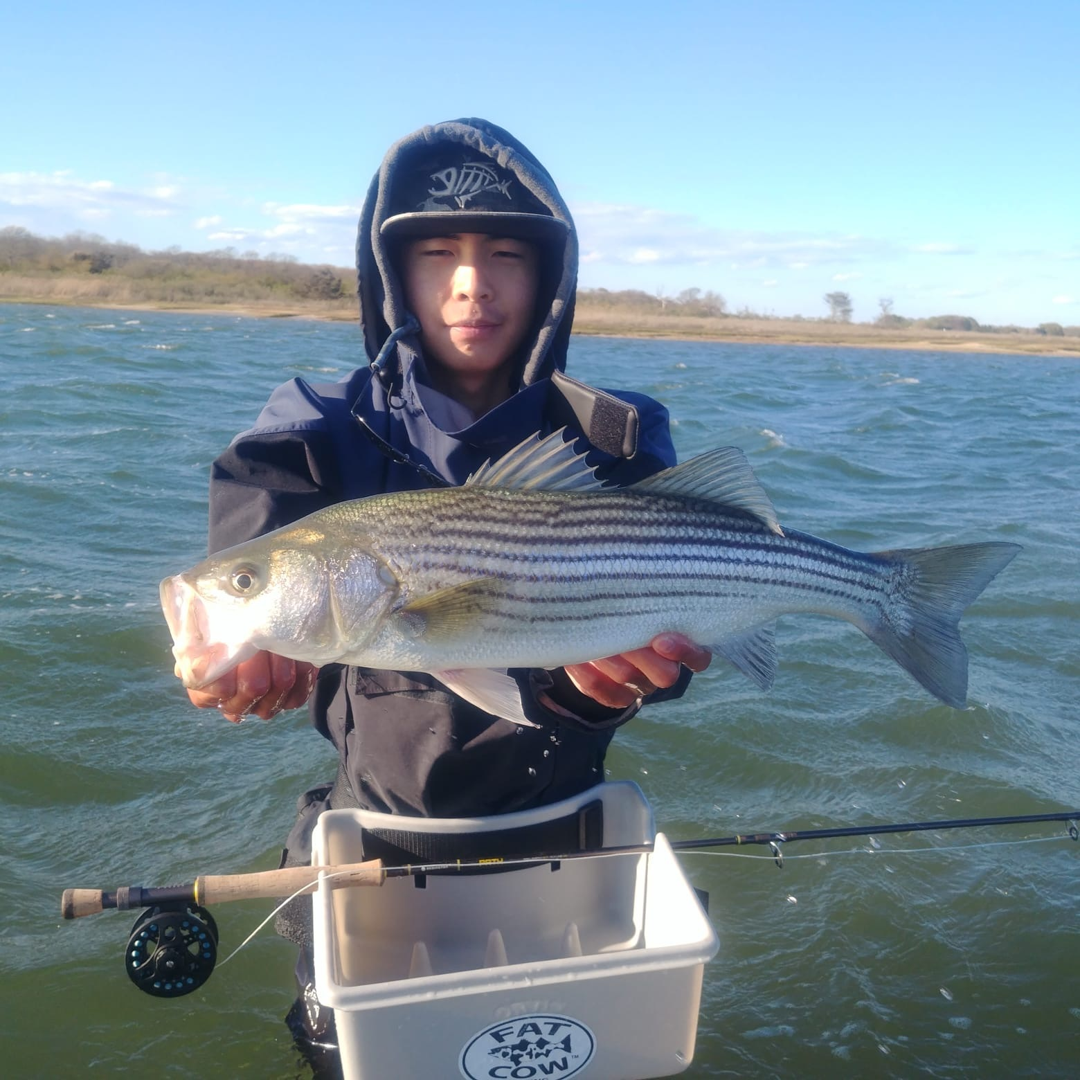 Jacky Long with a nice striped bass on fly caught in Shinnecock Bay recently.